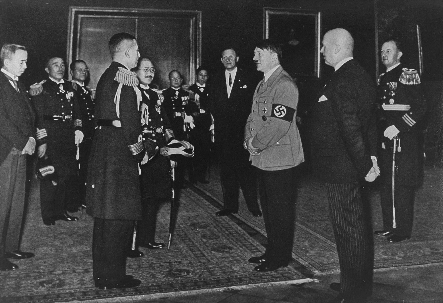 Adolf Hitler greets a Japanese naval delegation.