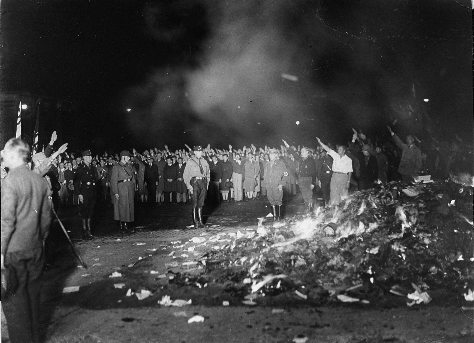 "The public burning of ""un-German"" books by members of the SA and university students on the Opernplatz in Berlin."