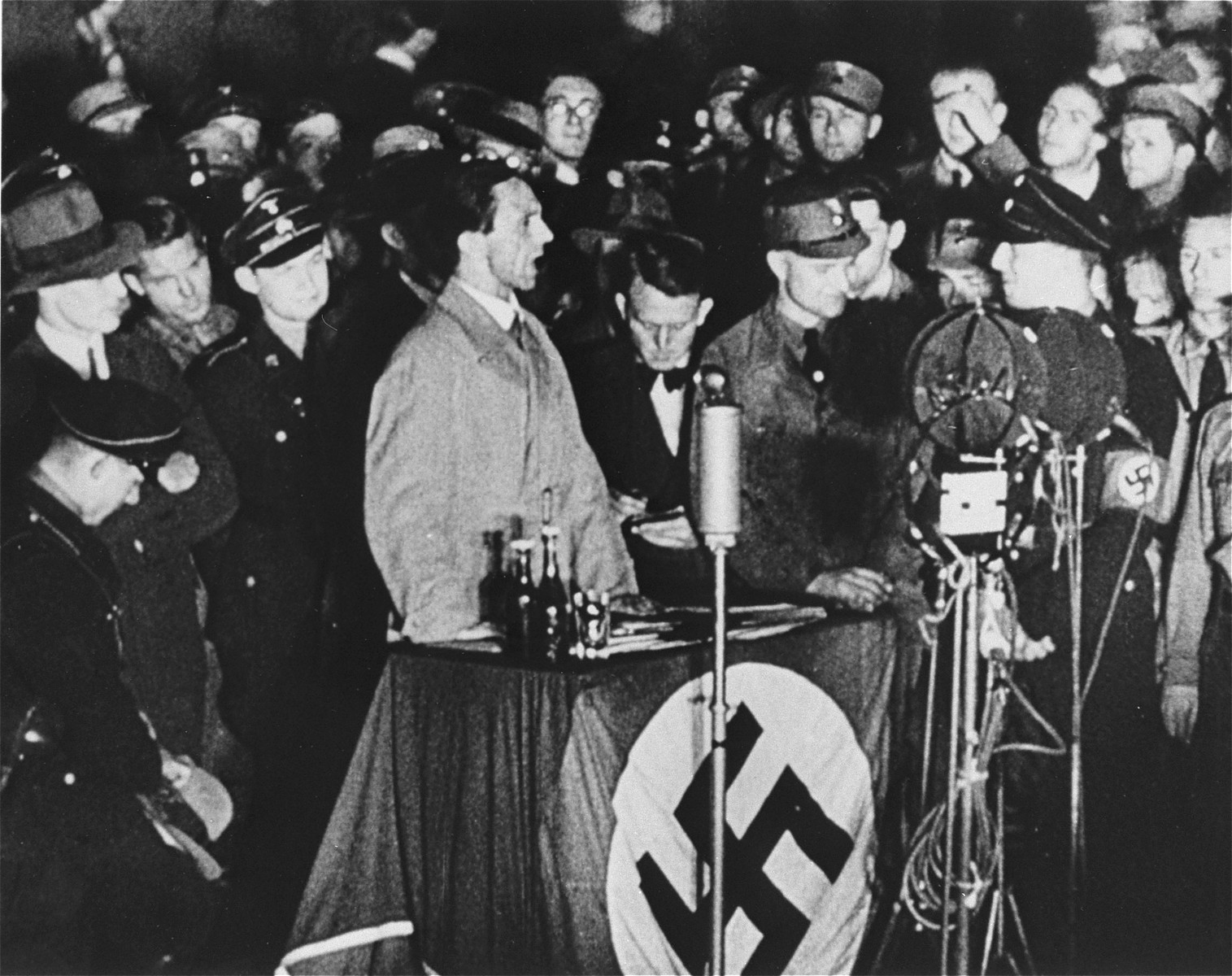 Reich Minister for Public Enlightenment and Propaganda, Joseph Goebbels, delivers a speech during the book burning on the Opernplatz in Berlin.   Still from a motion picture.
