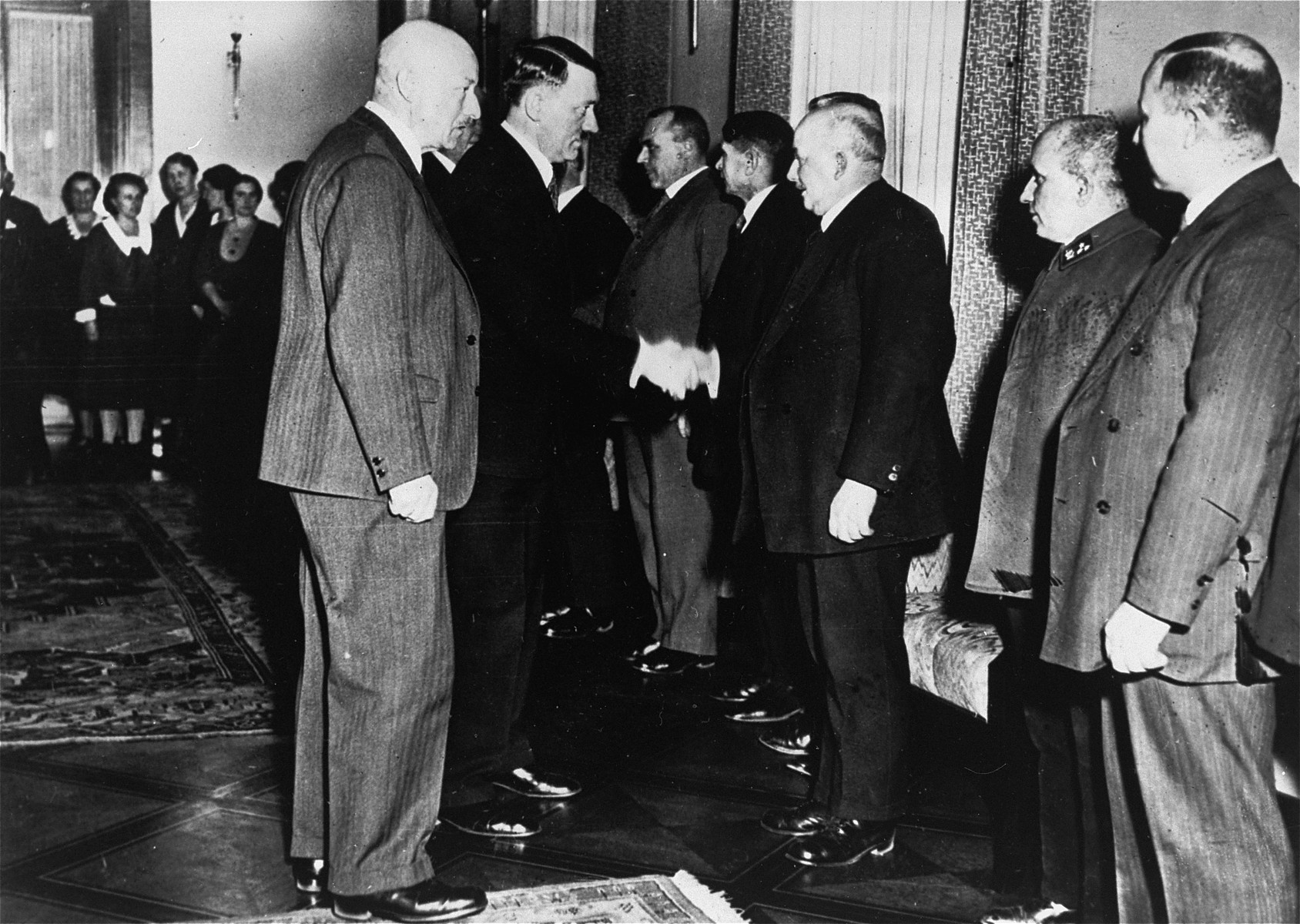 Adolf Hitler greets a group of unidentified dignitaries.
