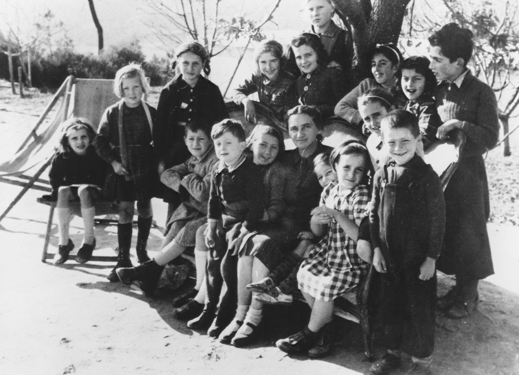 Group portrait of children hiding in the MACE (Maison d'Accueil Chretienne pour Enfants) home in Vence.  Those pictured include Marek Adamel, Judith Sachs, Martha Levai, Helene Steinmetz, Gertrude Reisz, and Alice Waldman, Celine Sachs.