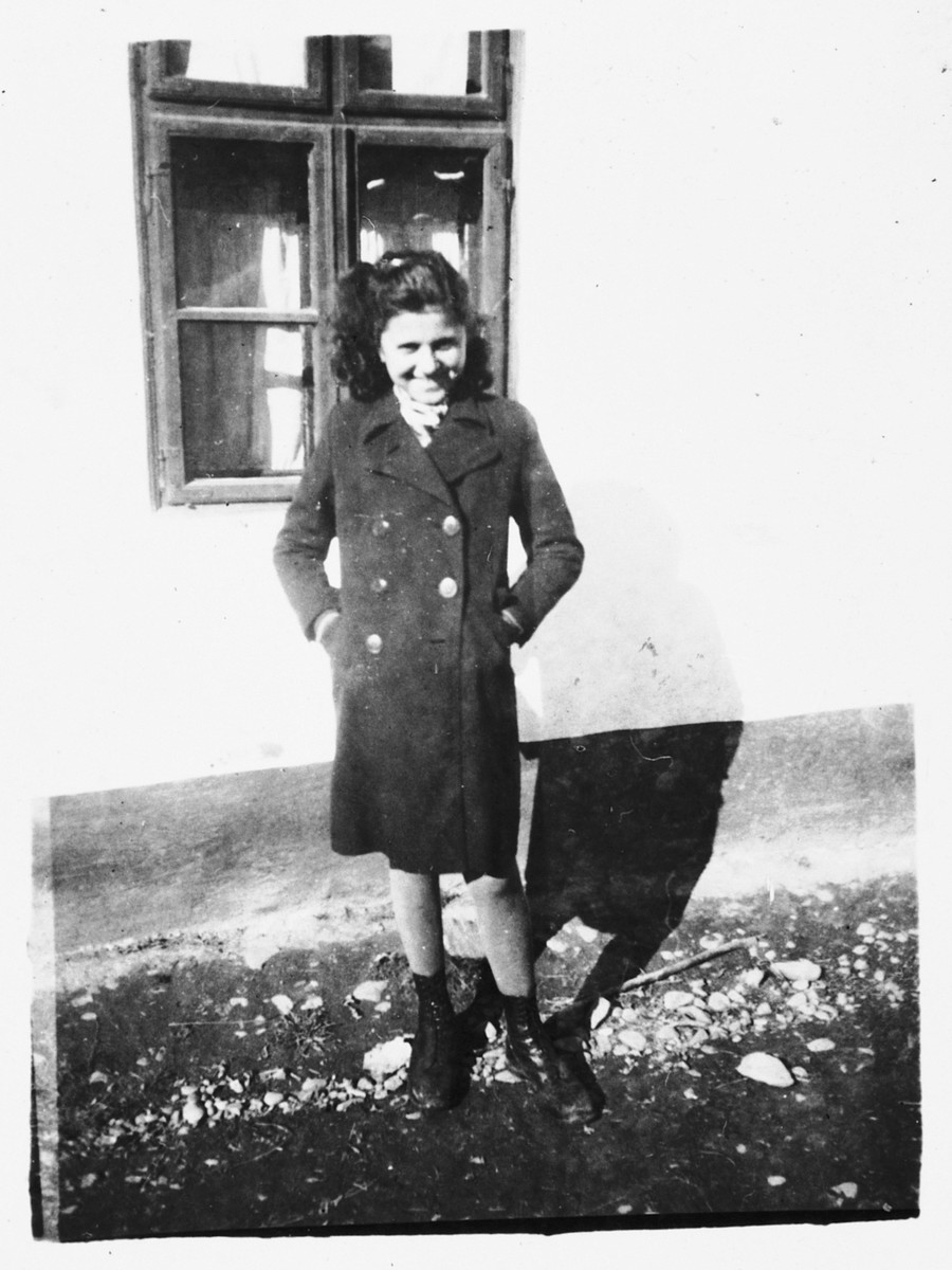 A Jewish girl poses outside her home in Bilki.  Pictured is Magdalena Mermelstein.