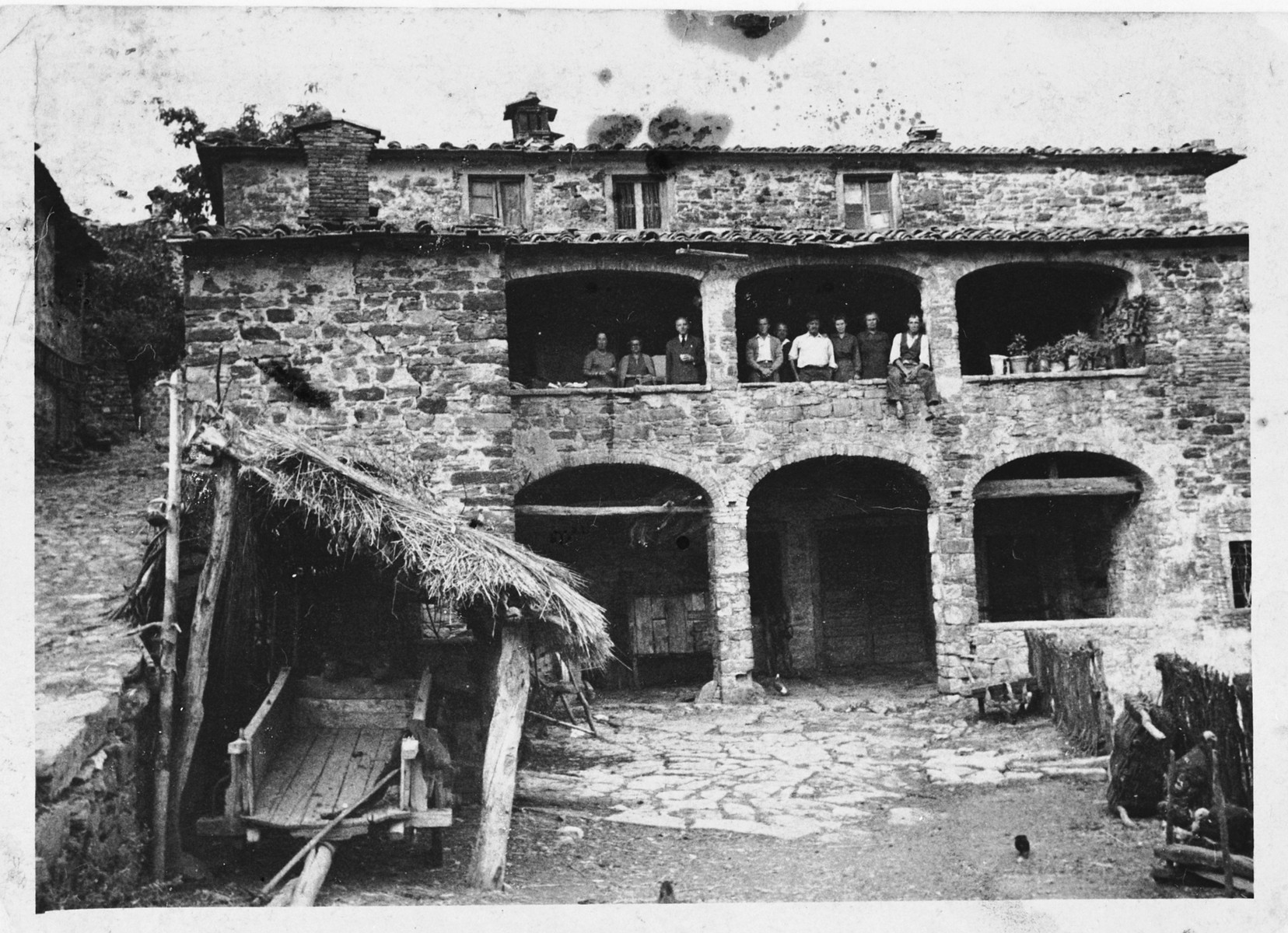 Greek POWs look out the balcony of a barracks in a camp in Arezzo, Italy.