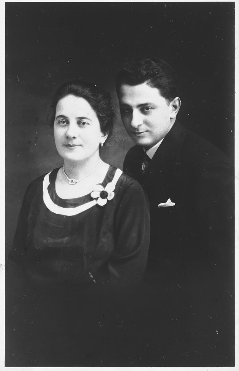 Gizella Helperin poses with her son Erno.  Erno Helperin worked as a newspaper reporter before the war.  He escaped from slave labor and rejoined his mother.  In April 1944, when he learned that the two of them were about to be deported, he gave his mother poison and then hanged himself.