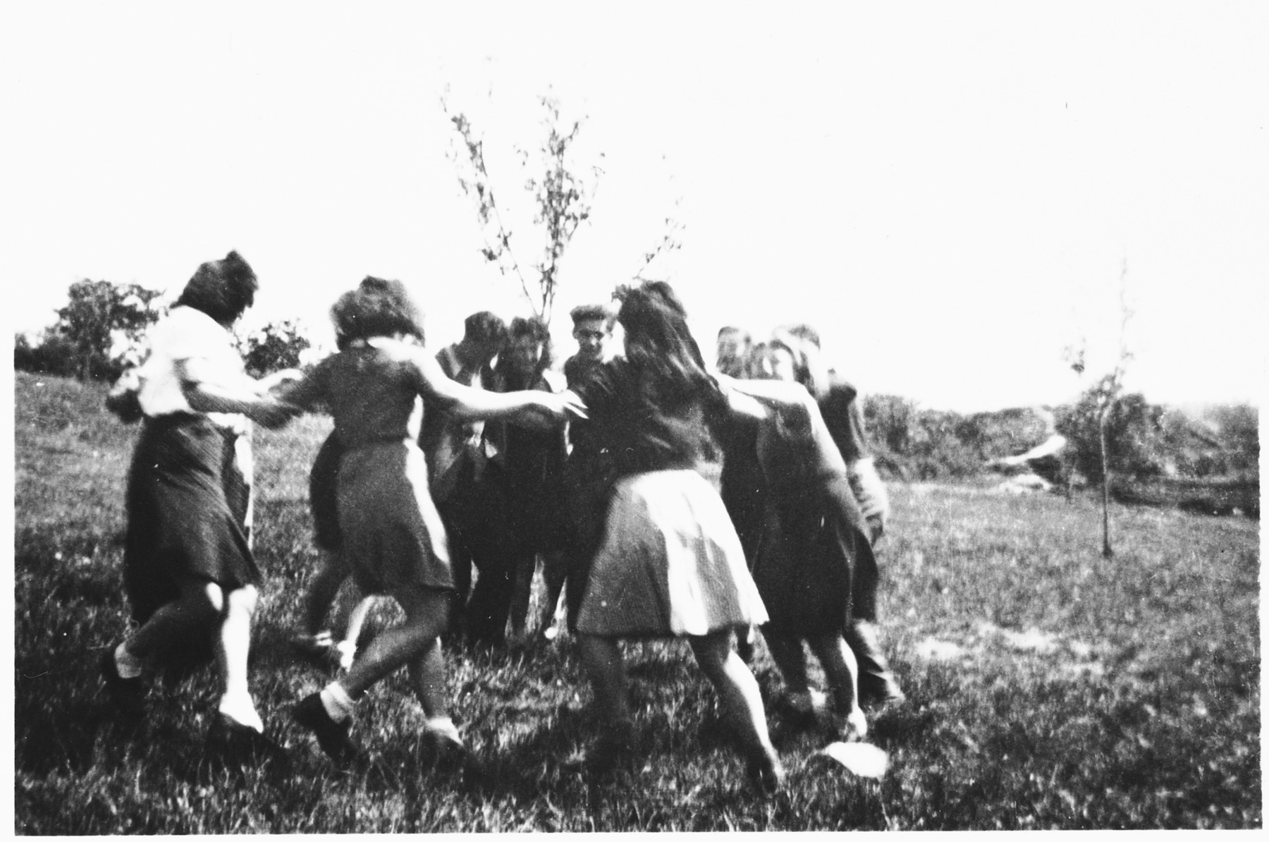A group of teenagers dance a hora outside the Poulouzat children's home.