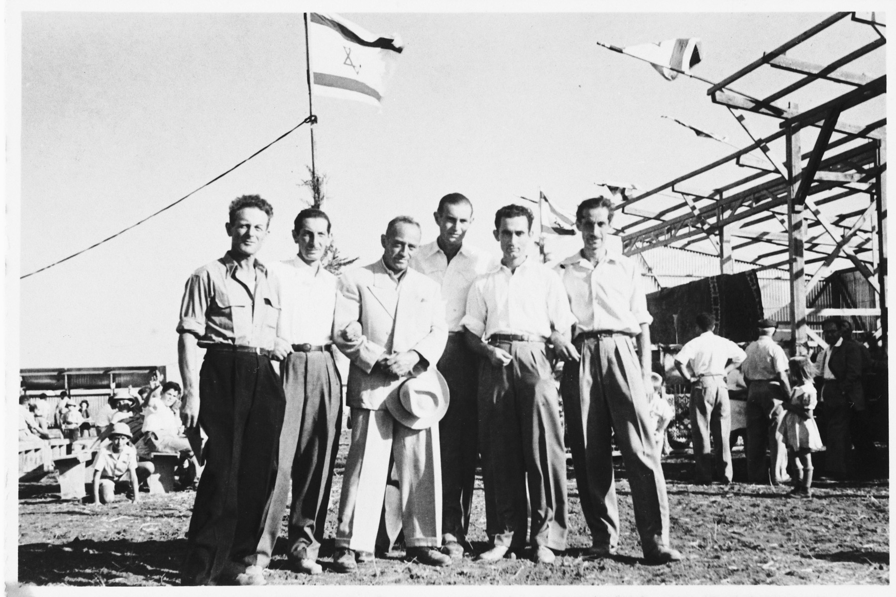 Group portrait of Jewish survivors from Yugoslavia on the new agricultural settlement, Moshav Kidron in Israel.  Among those pictured is Marko Spitzer (third from the left).