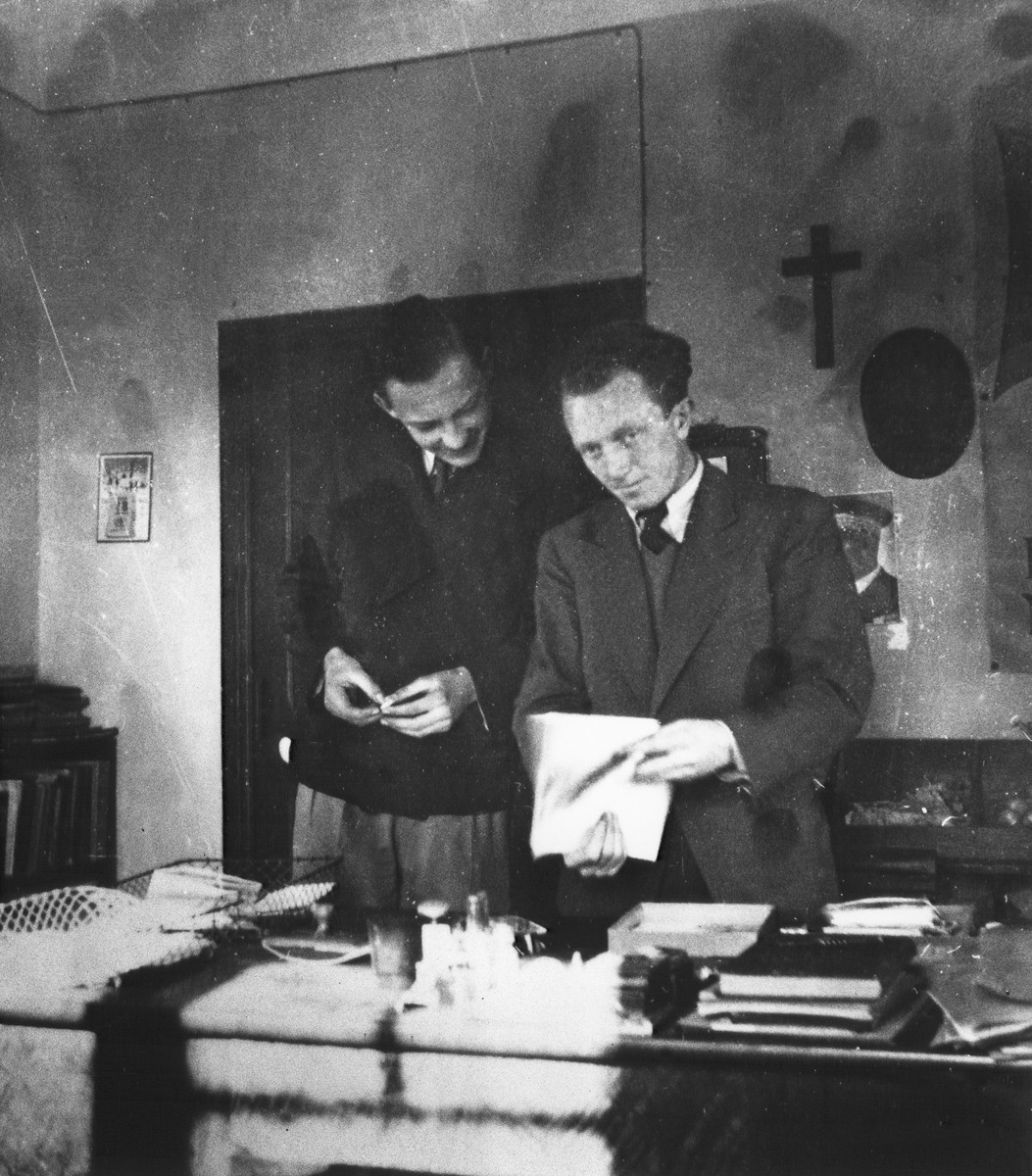 Joseph Fisera and a colleague look over some papers in his office in the Vence children's home.
