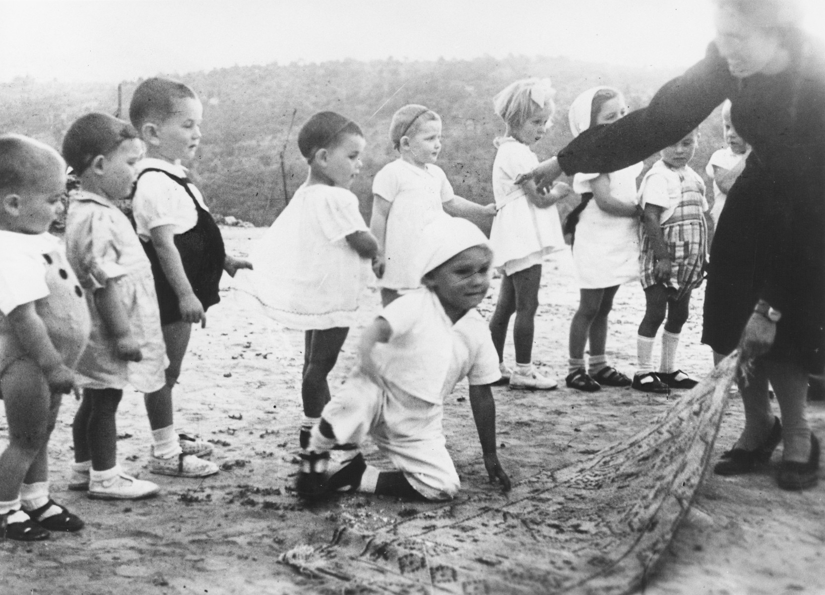 Julie Hermanova, a Czech Jewish nursery teacher, leads a circle game in the MACE children's home in Vence.
