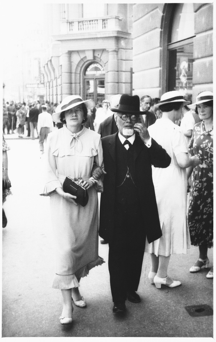 Silva Basch walks down a street in Zagreb accompanied by her father, Rabbi Leopold Deutsch.