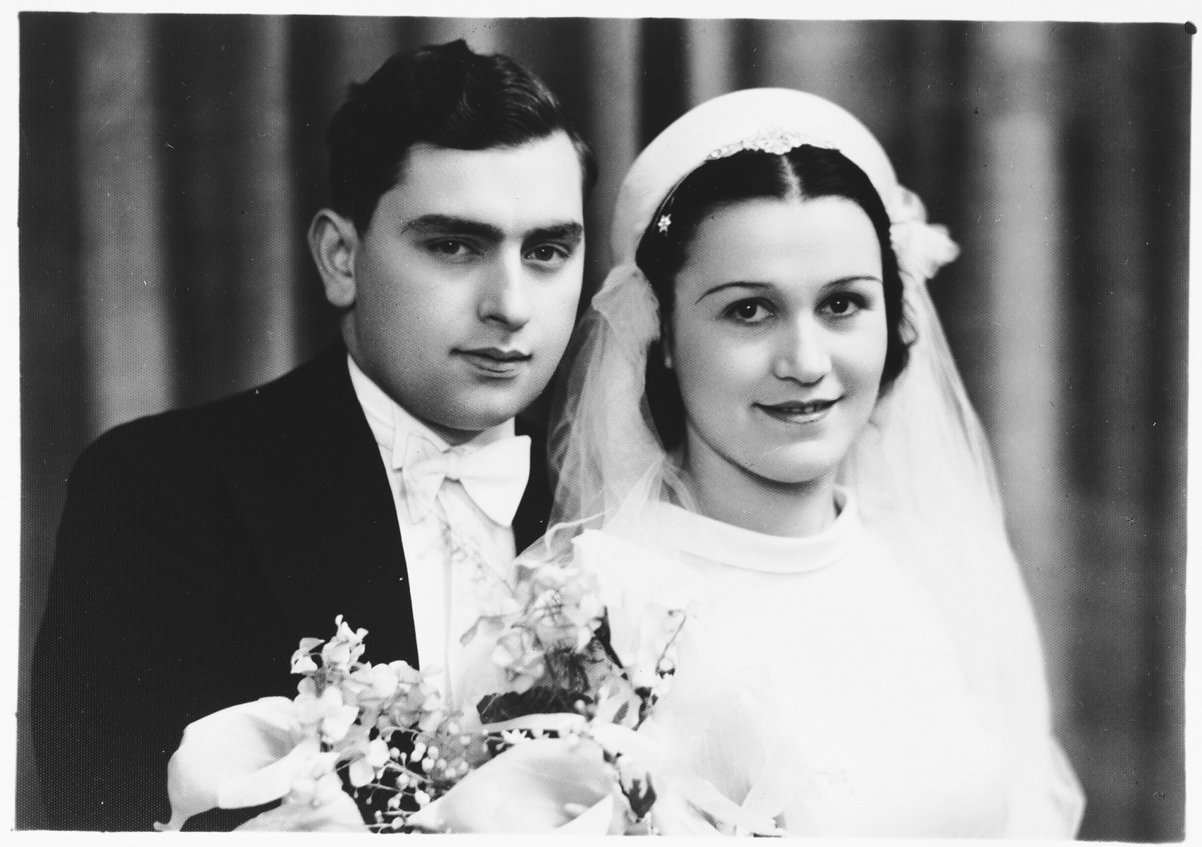 Wedding portrait of a Jewish couple, Adolf and Estera Ciechanow in Antwerp, Belgium.  Adolf and Estera are the brother and sister-in-law of Alex Ciechanow.