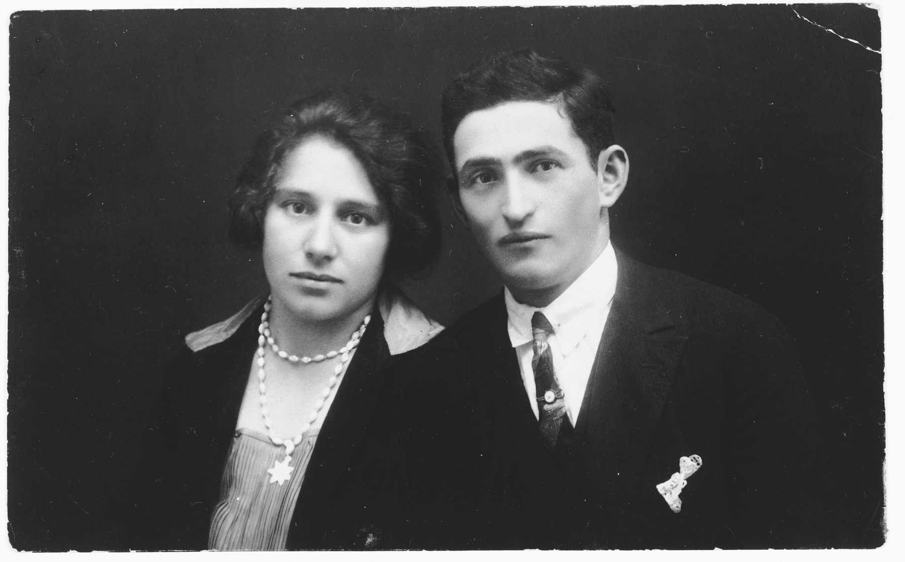 Portrait [probably an engagement photograph] of Irina Farkas and Eugene Berkovits.