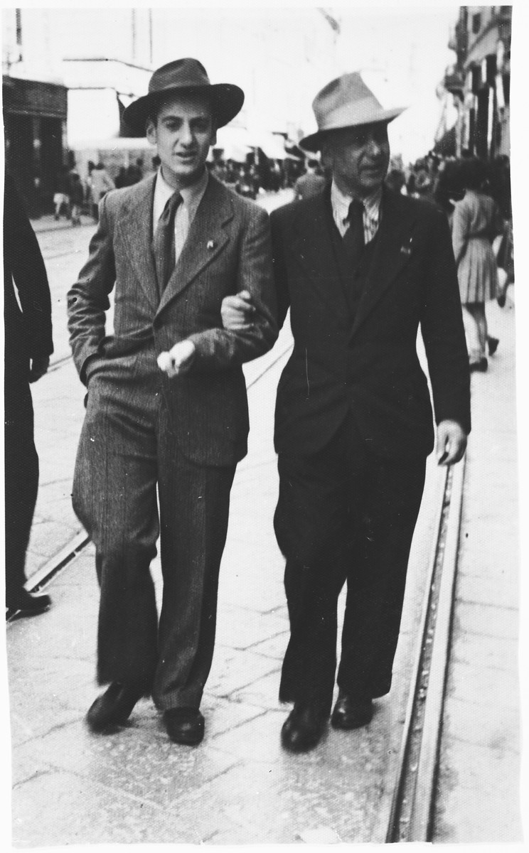 Aldo and Eugenio Foa walk arm in arm along a street in Parma shortly before they were forced to go into hiding.