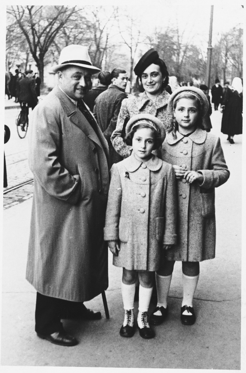 A Jewish family poses on a street in Osijek, Croatia.  Pictured clockwise from the left are: Marko, Ilonka, Miriam and Leah Spitzer.