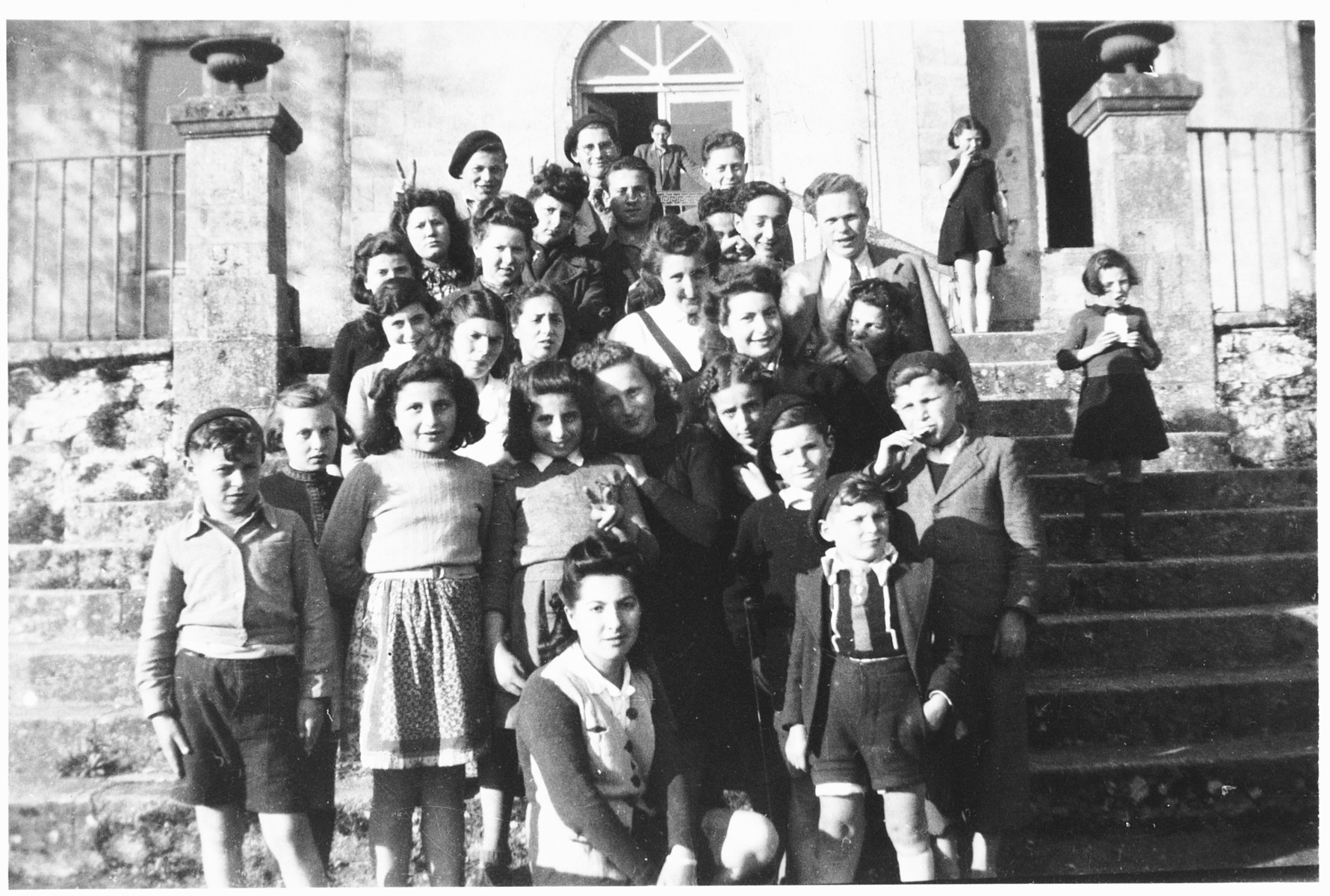 Group portrait of Jewish DP youth on the steps of the La Borie children's home.  Among those pictured are Ruth Zarnicer, Hugo Zarnicer, Rachel Bensanson, Herbert Karliner and Charles Hausman (back row, left).