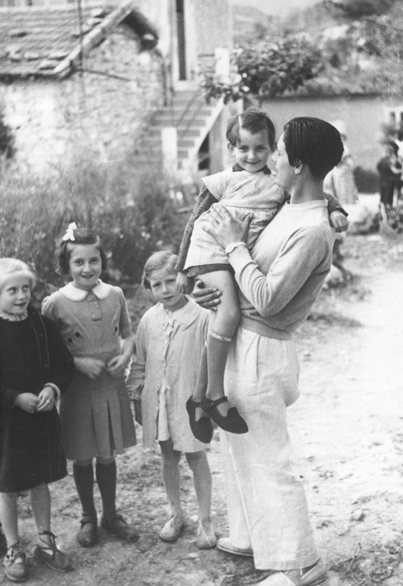 Karol Pajer, a former Slovak soldier and a teacher in the MACE (Maison d'Accueil Chretienne pour Enfants) children's home in Vence, holds one of the younger children.  After the dissolution of the home, Pajer joined the Maquis.