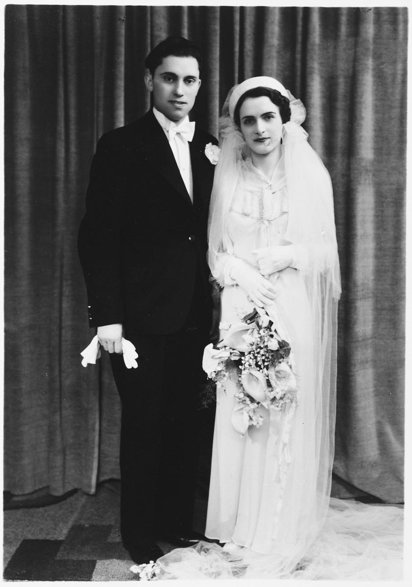 Wedding portrait of a Jewish couple, Leah Mendelowicz and Alex Ciechanow, in Antwerp, Belgium.