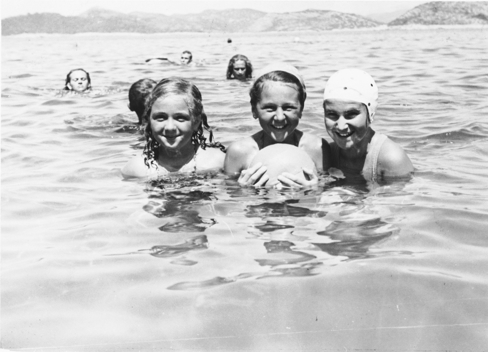 A Jewish family swimming in the Adriatic Sea.  Pictured are members of the Spitzer family on vacation on the island of Lopud, where during WWII they would be imprisoned in an Italian internment camp.