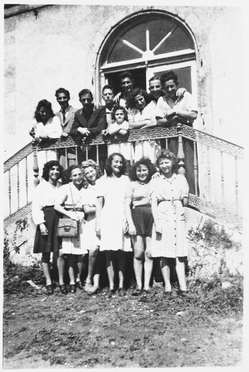 Group portrait of Jewish DP youth at the entrance to the La Borie children's home.  Those pictured include, Suzanne Weisfeld (front row, second from the left), Suzanne Kleinbaum (front row, center), Max Kleinbaum, (top row, fourth from the right), and Lutz Scheuchter (top row, second from the right).