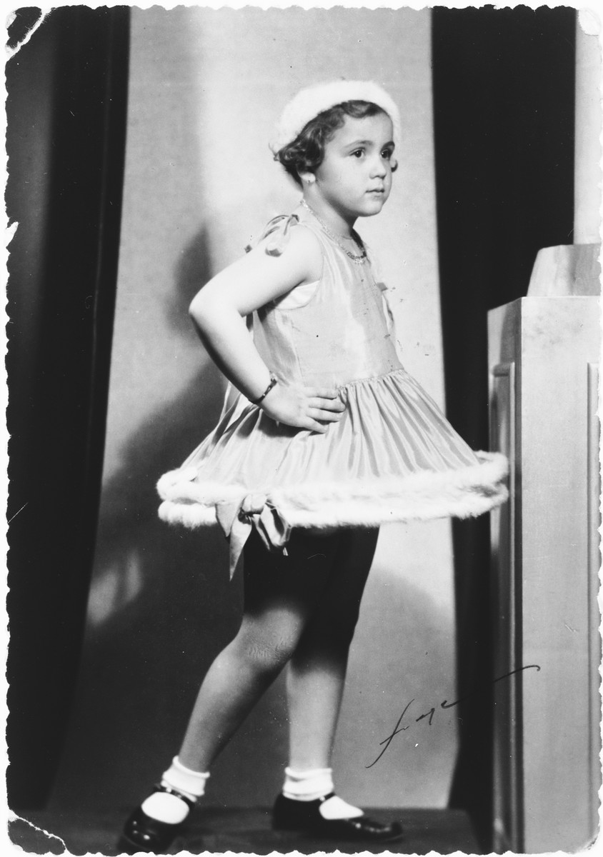 Portrait of a young Jewish girl dressed in a powder puff costume for Purim.  Pictured is Miriam Spitzer.