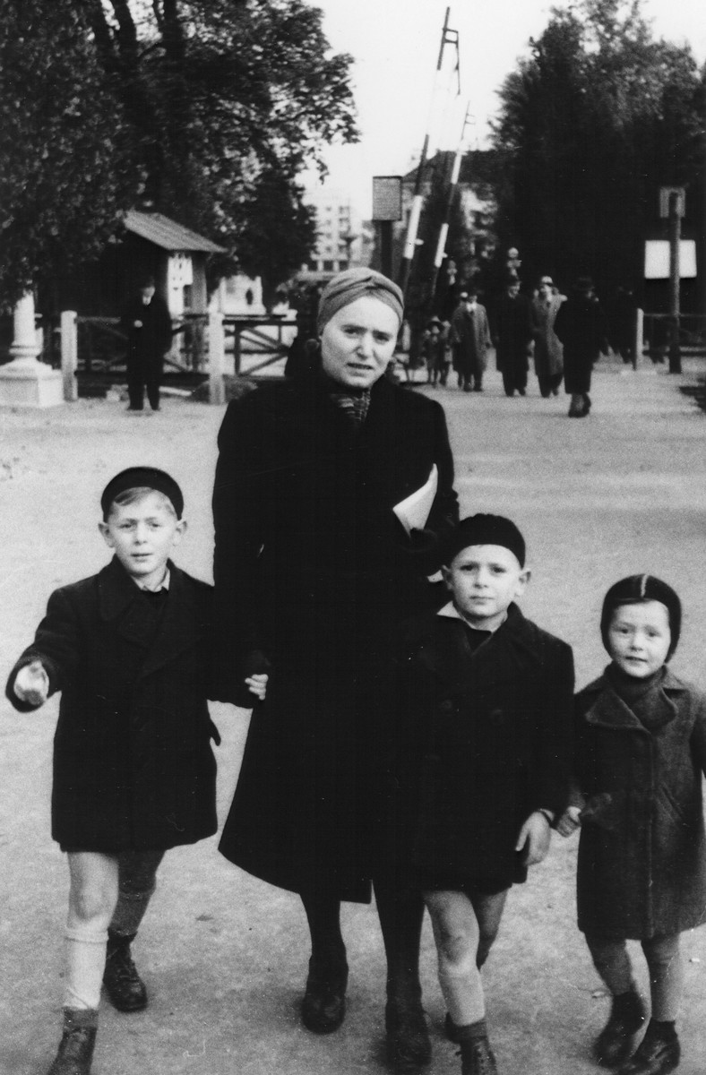 A Jewish refugee family from Croatia walks along a street in Italian-occupied Ljubljana after fleeing from Zagreb.  Pictured is Gabriela Deutsch with her three sons, Pavel, Branko, and Djordje.