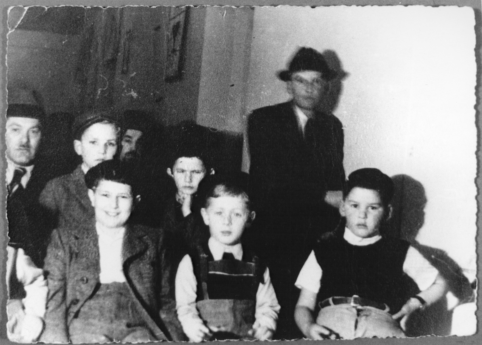 Group portrait of teachers and pupils at a cheder [Jewish religious primary school] in Zagreb.  Among those pictured is Pavel Deutsch (front row, center).
