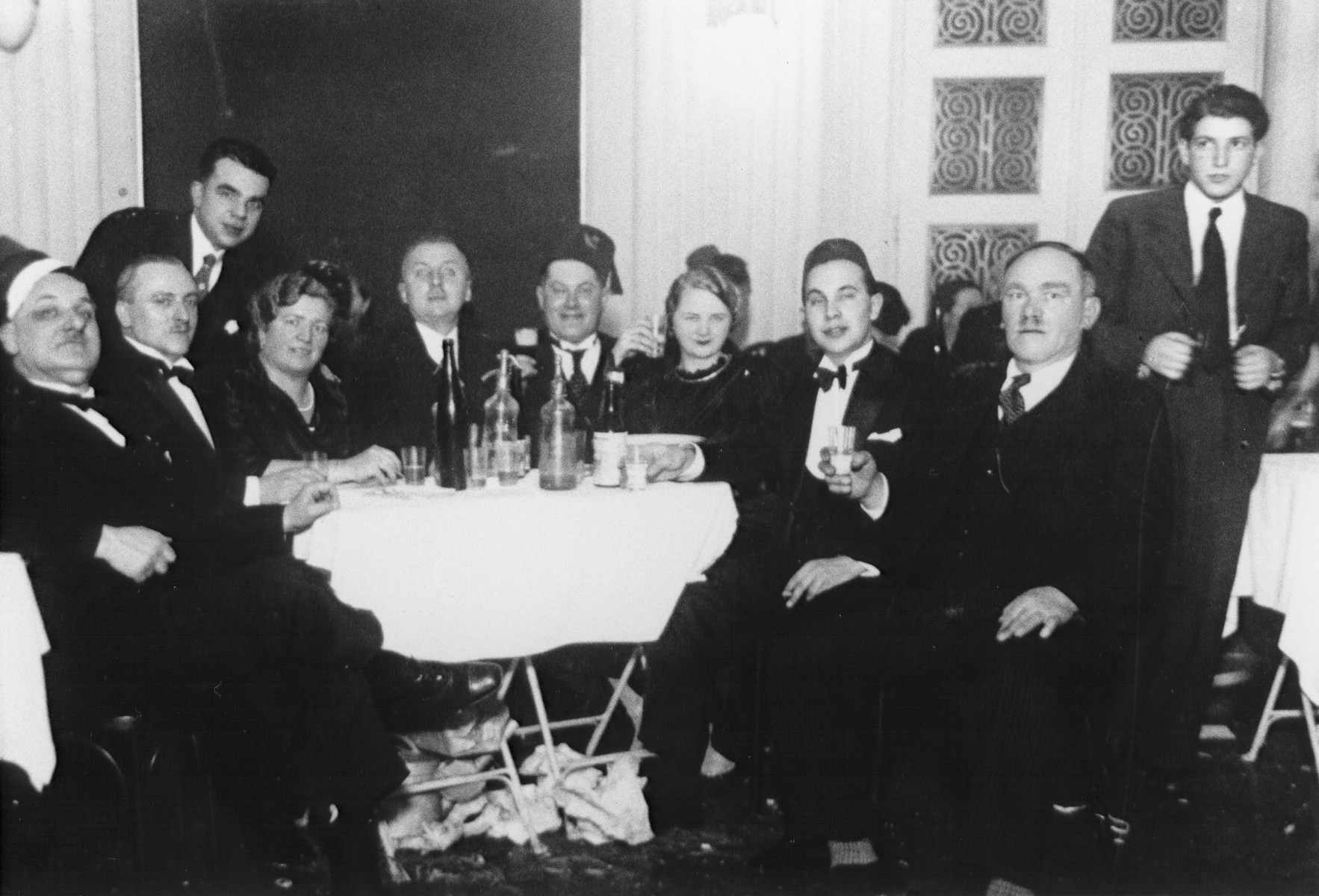 A group of Jewish friends in Zagreb raise their glasses at a social gathering to celebrate the holiday of Purim.  Among those pictured is Josef Deutsch(center wearing a Turkish hat).