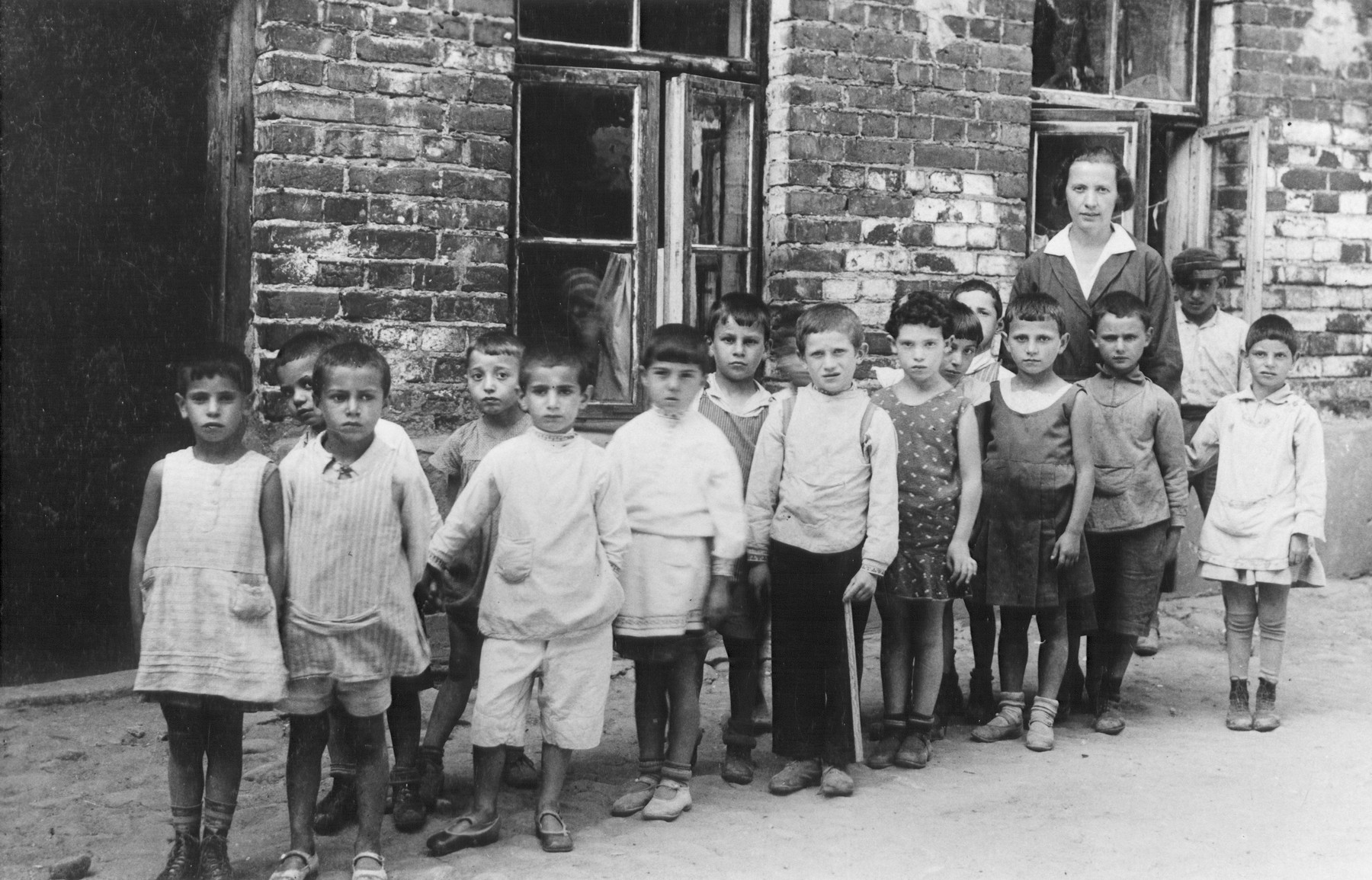 Children from the Jewish kindergarten in Kaunas (located at 9 Mapu Street) pose outside their school before leaving on an outing.