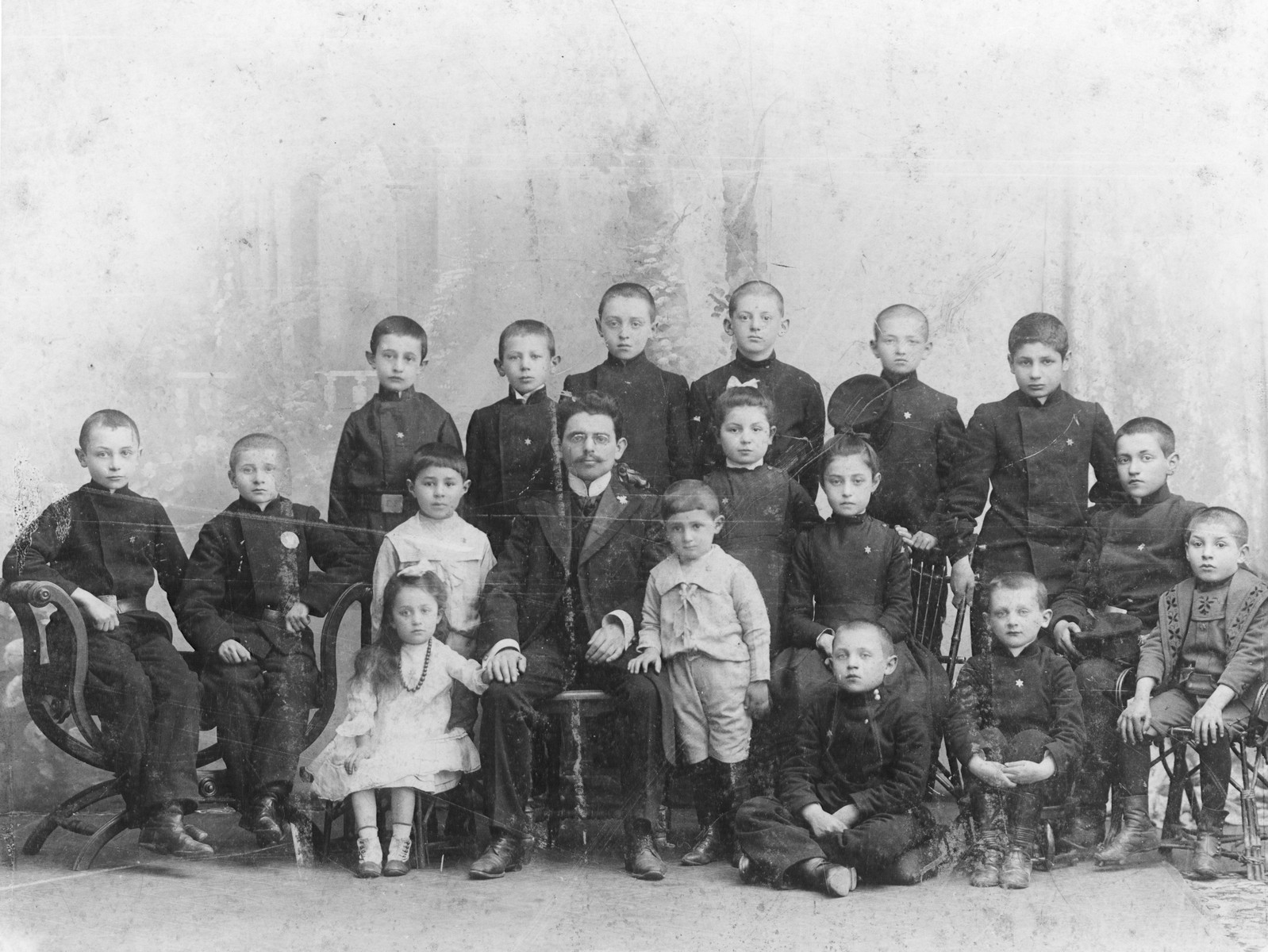Group portrait of students in a Jewish school in Kovno, Lithuania at the turn of the century.  Pictured in the center is the teacher, Mr. Prokovnik.
