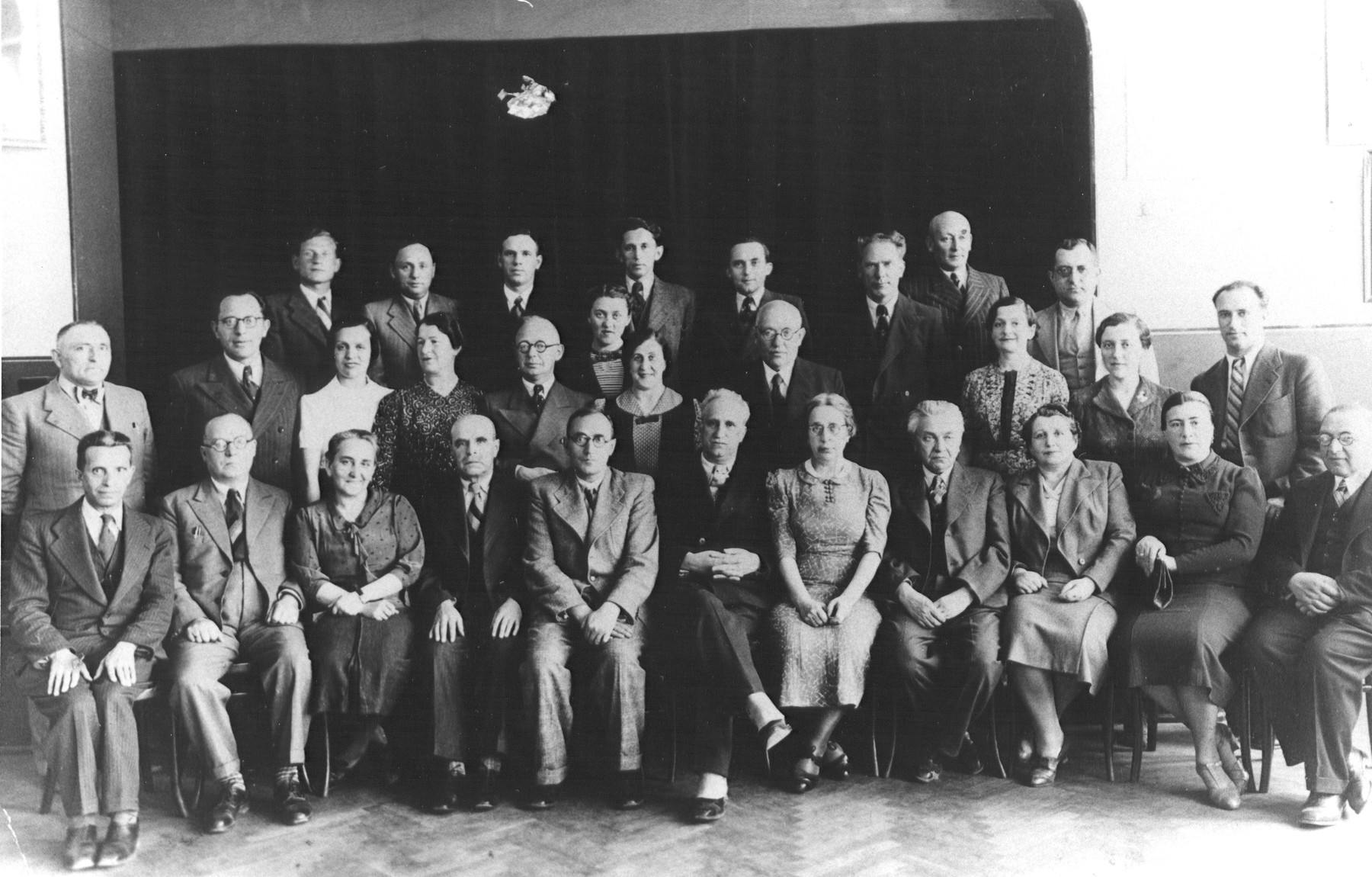 Group portrait of the faculty of the Hebrew Real Gymnasium in Kovno, Lithuania.  Seated in the center is the pricipal, front row (fifth from left) is the principal Dr. Kissin.  Standing in the top row on the far right is Shalom Tzvi Rachokovsky.