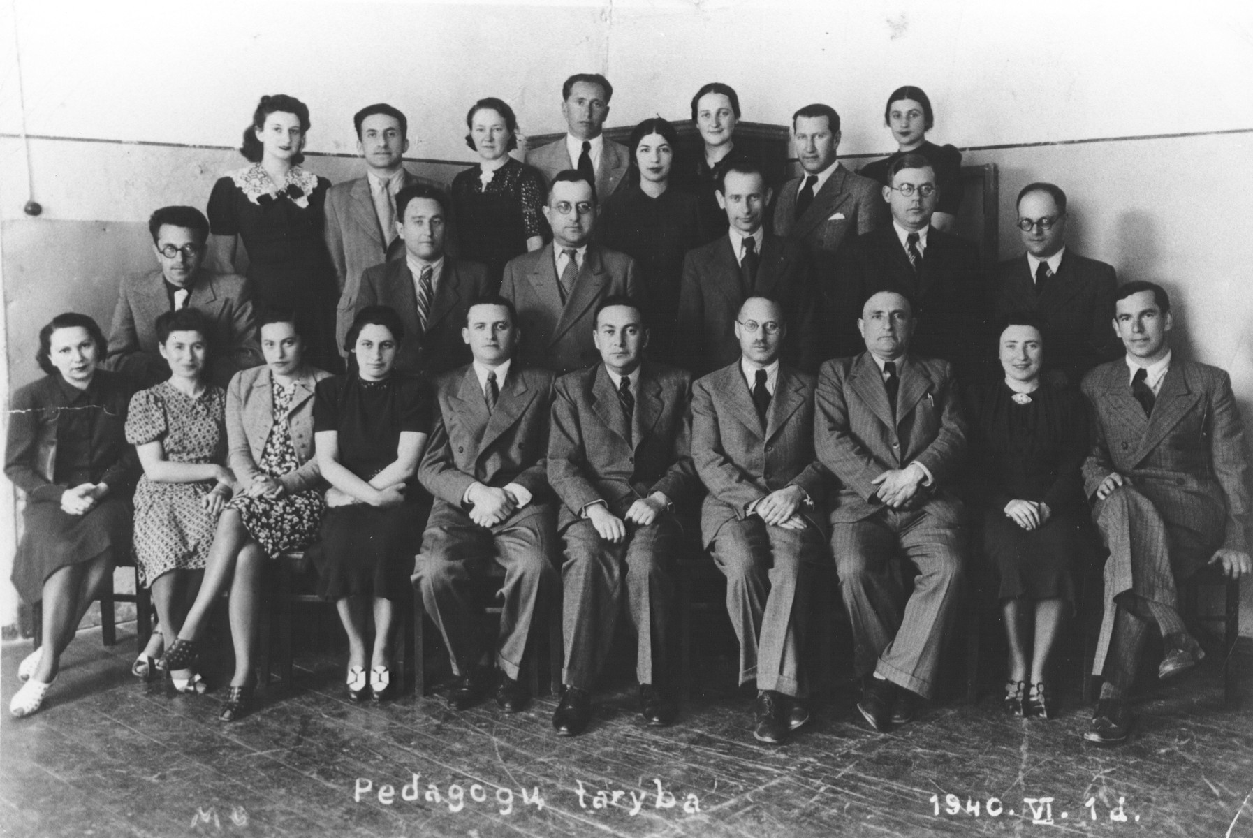 Group portrait of the faculty of the Hebrew Real Gymnasium in Kovno, Lithuania.  Standing in the second row, fourth from the right is Shalom Tzvi Rachokovsky.