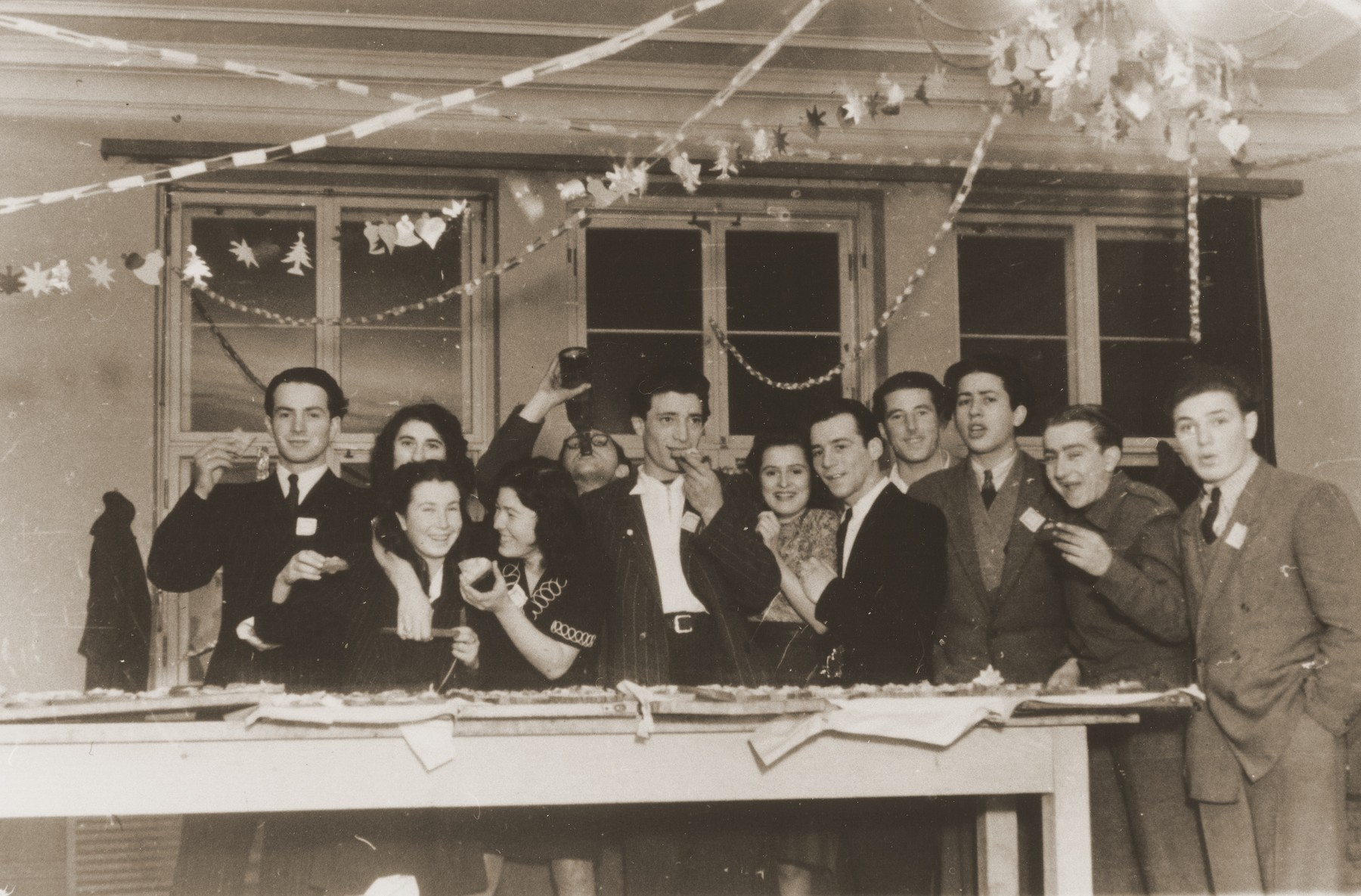 Members of the Kibbutz Haghibor hachshara hold a party in the Bergen-Belsen DP camp.
