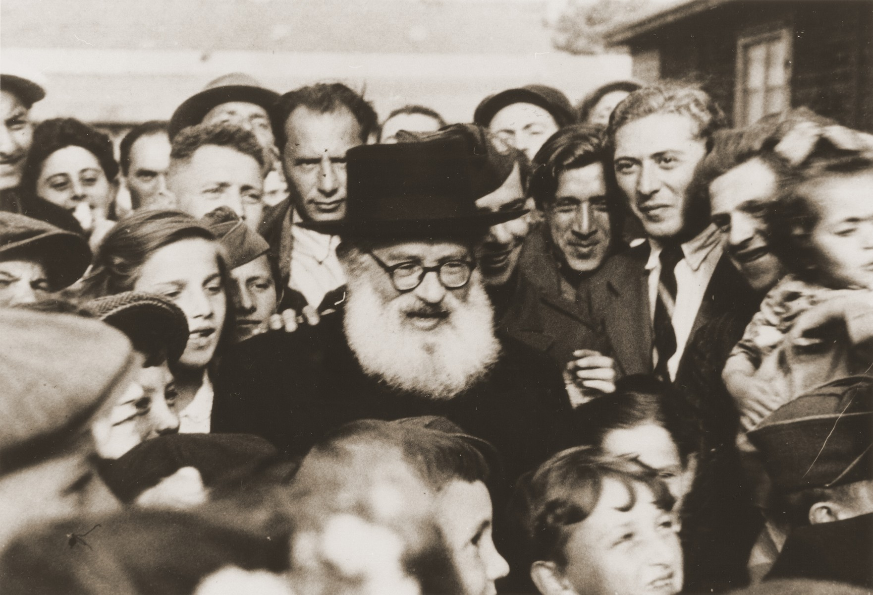Rabbi Isaac Herzog, Ashkenazi chief rabbi of Palestine, addresses a crowd during an official visit to one of the displaced persons camps.