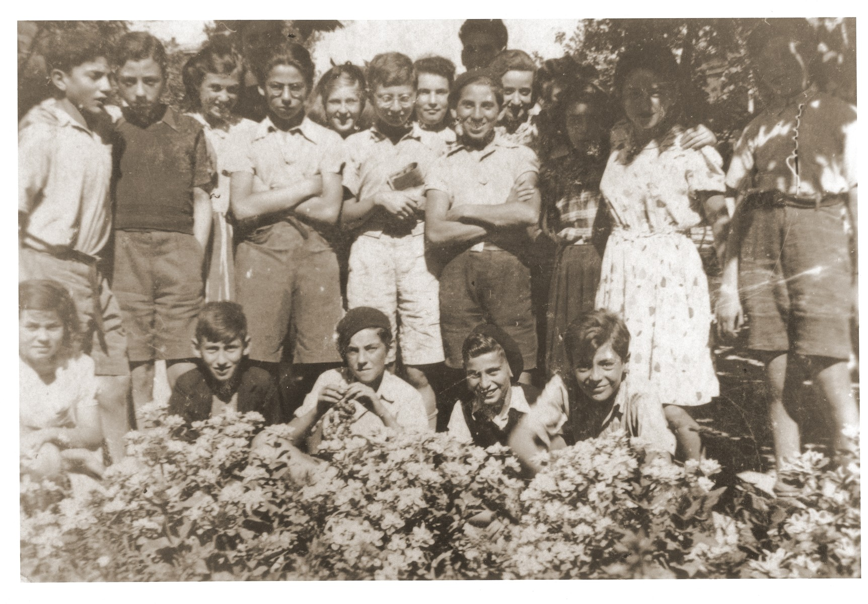 Group portrait of Jewish children under the care of the OSE (Oeuvre de Secours aux Enfants) at the Hotel Bompard internment camp.    Siegfried Weissmann is pictured standing fourth from the right in the second row.  Theodore Brenig is standing fourth from the left.  Bernhard Guenter Katz is seated in the front, second from the left.