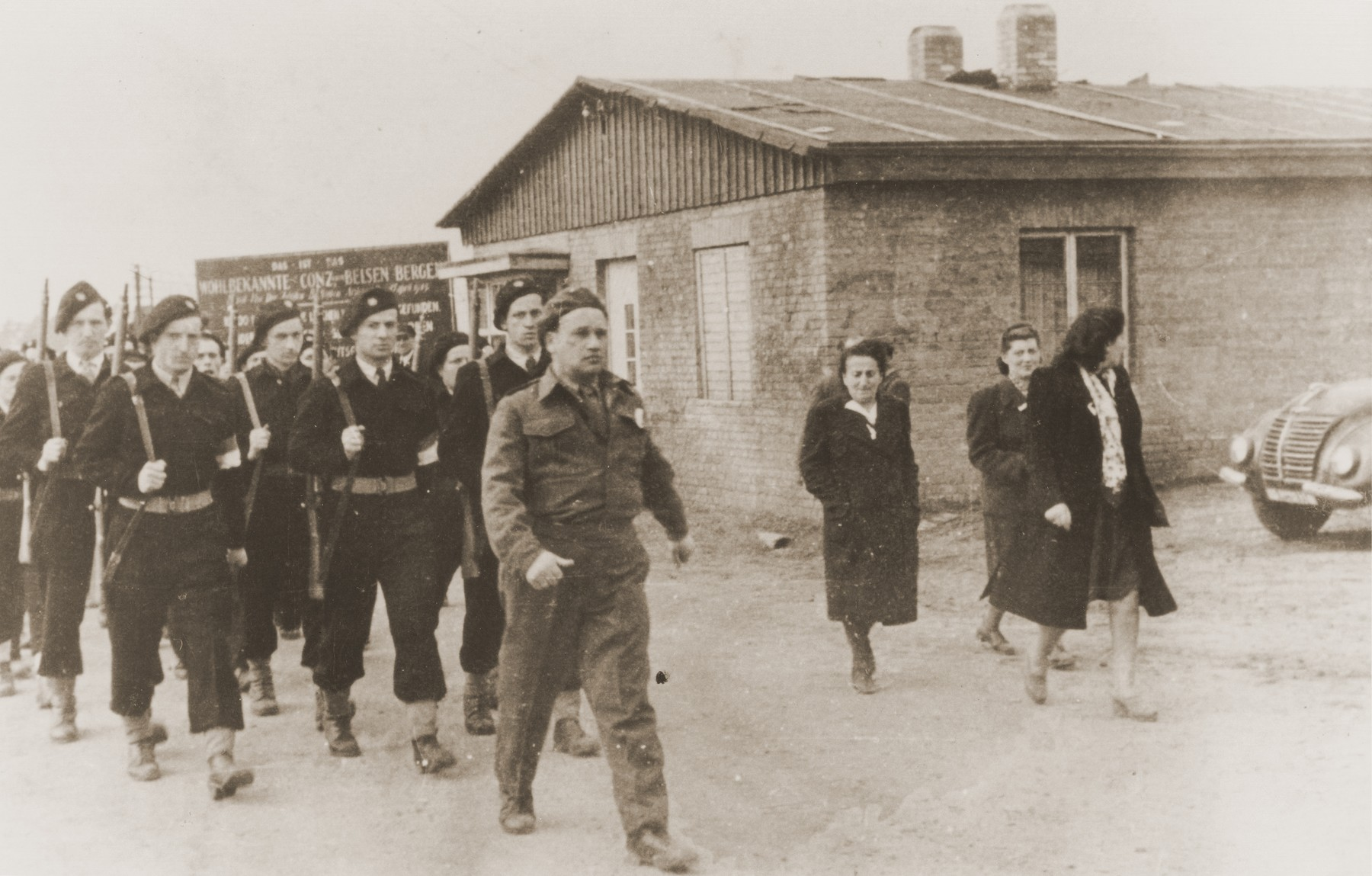 Jewish police parade through the Bergen-Belsen DP camp.  Nandor Aron is fourth from the left and Bundy Weiss is on the far left.