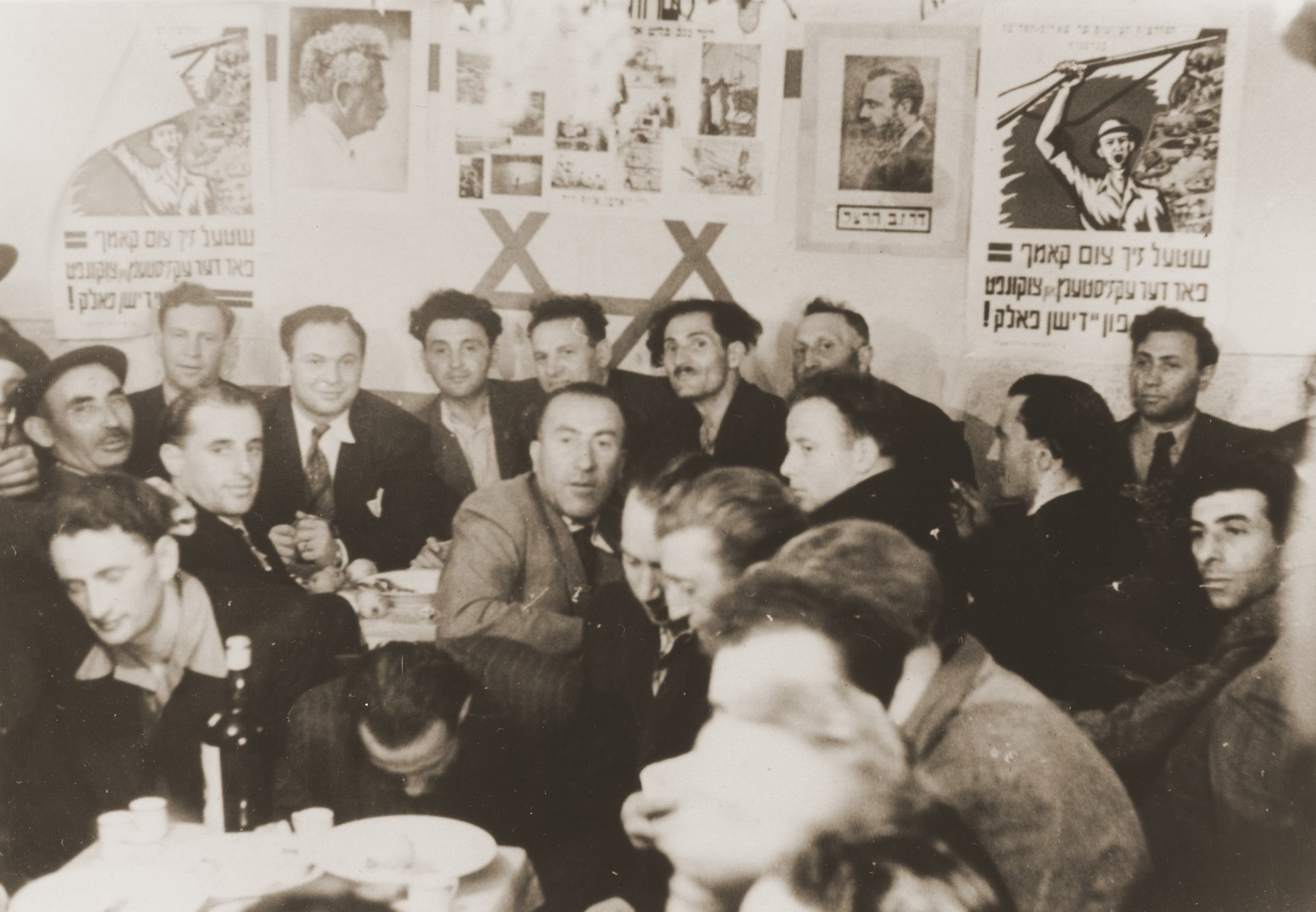 A Zionist gathering in the Neu Freimann displaced persons camp.  Leo Stern is pictured in the back row, far right.