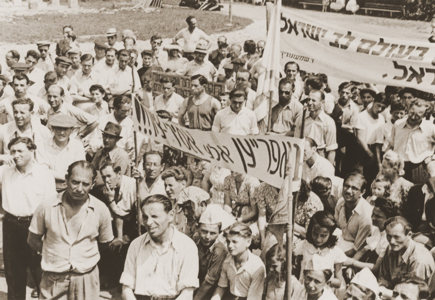 DPs in the Landsberg DP camp attend a demonstration to protest British immigration policy to Palestine.