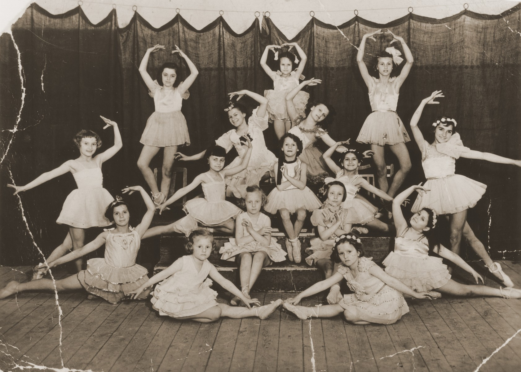 Group portrait of children dressed in tutus at a ballet class in Cluj.    Eva Aron is pictured at the bottom left.