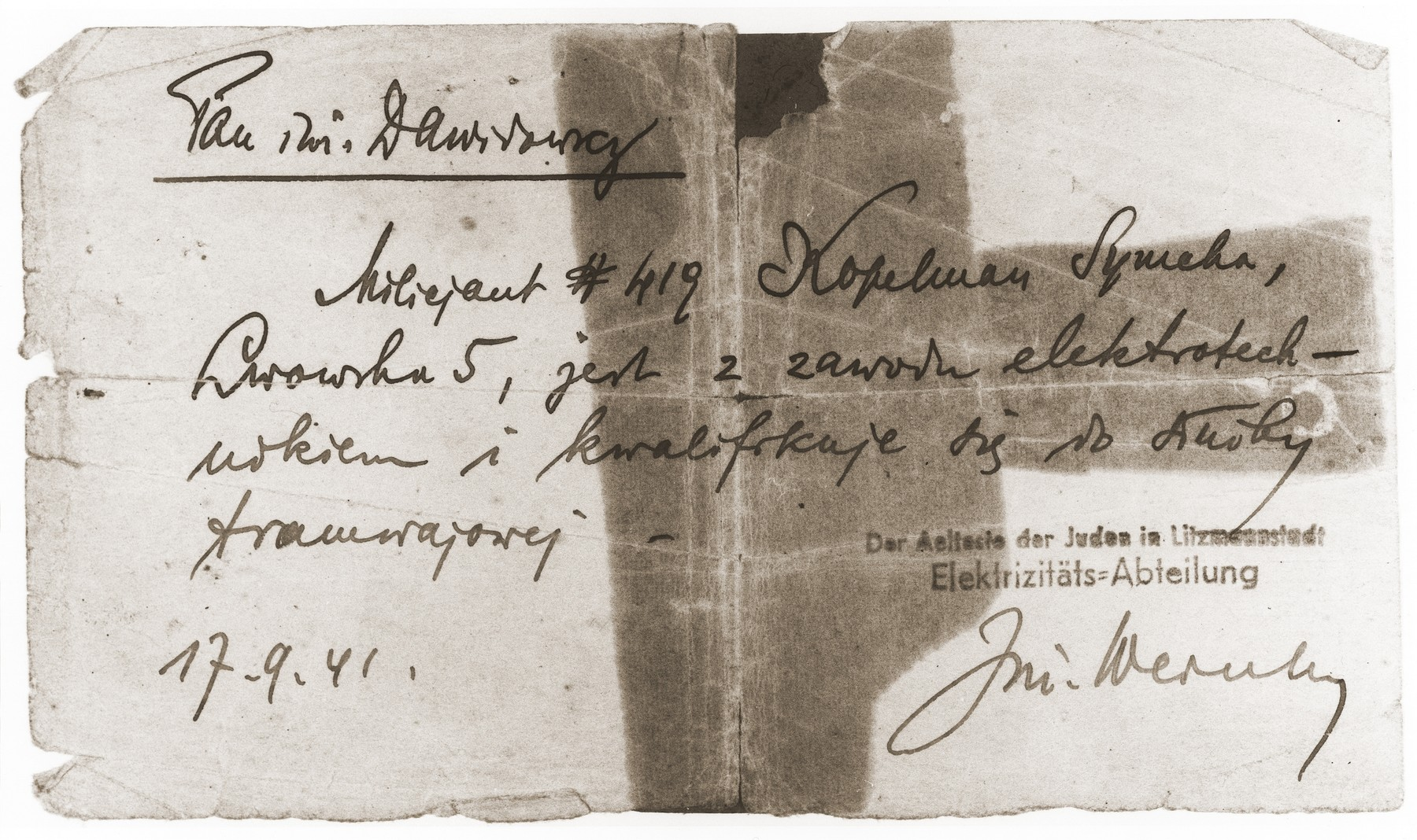 Referral notice signed by Engineer Dawidowicz recommending that Symcha Kopelman, currently a policeman, be given a job in the electrical department servicing streetcars.