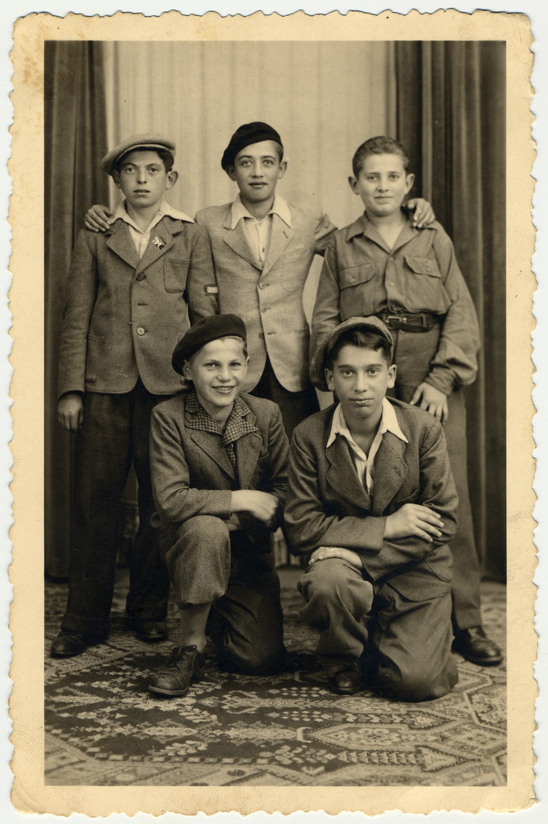 Group portrait of Jewish youth in the Taverny children's home, an OSE home for religious child survivors.  Among those pictured is the donor, Jakob Rybsztajn standing in the center.