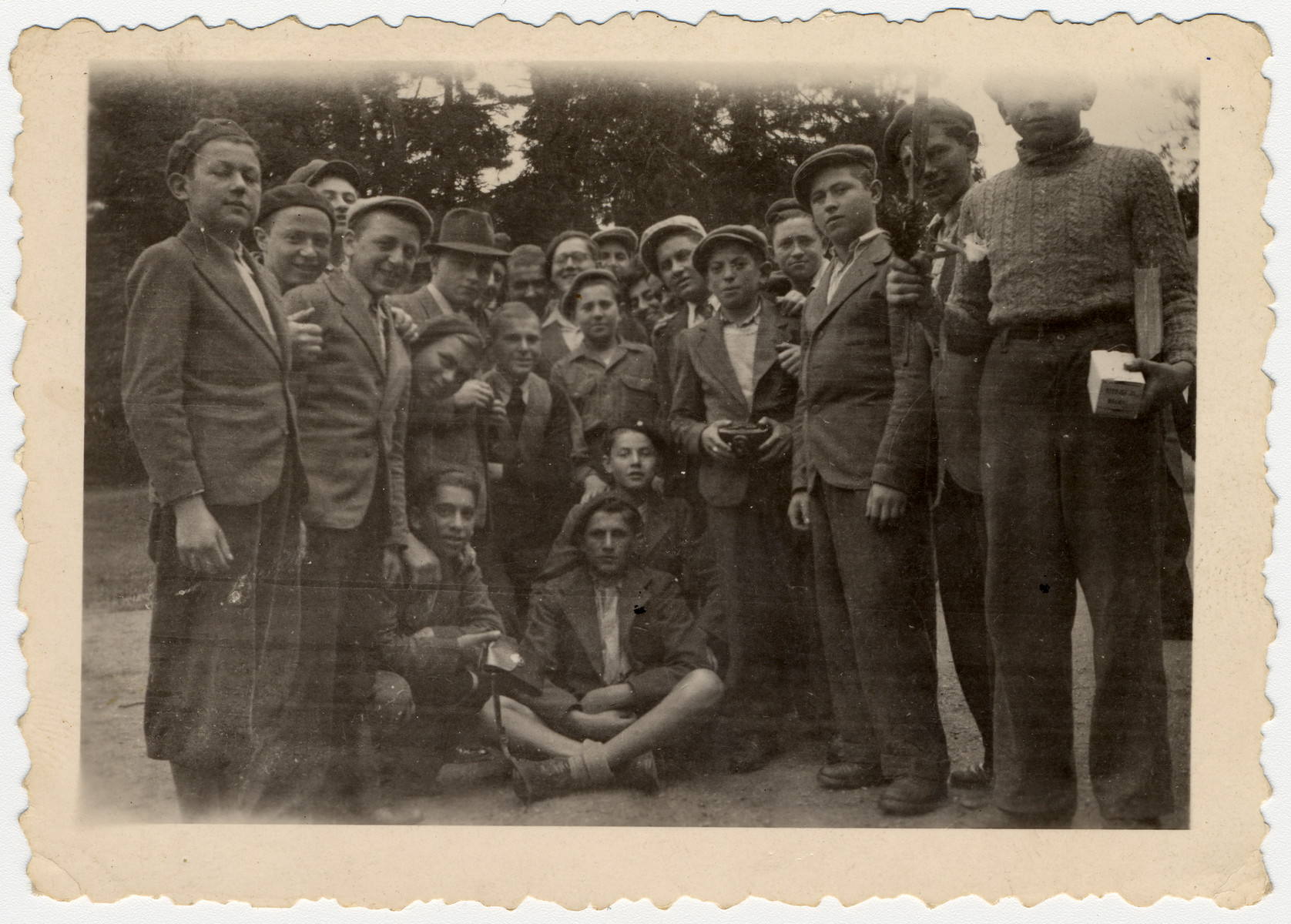 Group portrait of religious Jewish youth at either the Ambloy or the Taverny children's home.