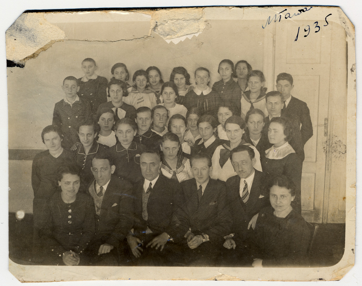 Students and teachers in the Jewish Gymnasium in Mlawa.  Seated in the first row are Dr. Rosenman (second from left), principal Icchak Hirszhorn (third from left) and Issachar Fater (fourth).