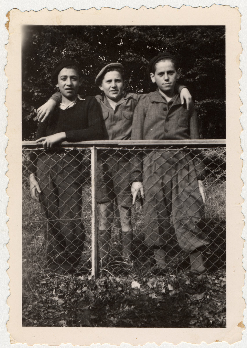 Close-up portrait of three Jewish youth in [what probably is] the Ambloy children's home.  Among those pictured is the donor, Jakob Rybsztajn (left) andJacques Finkelsztajn (center).