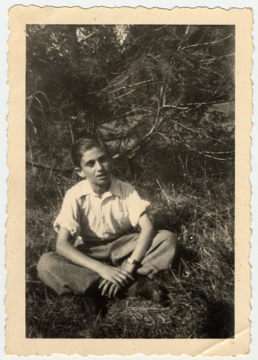 Close up portrait of a child survivor from Buchenwald.  Pictured is Bernard Rybsztajn.