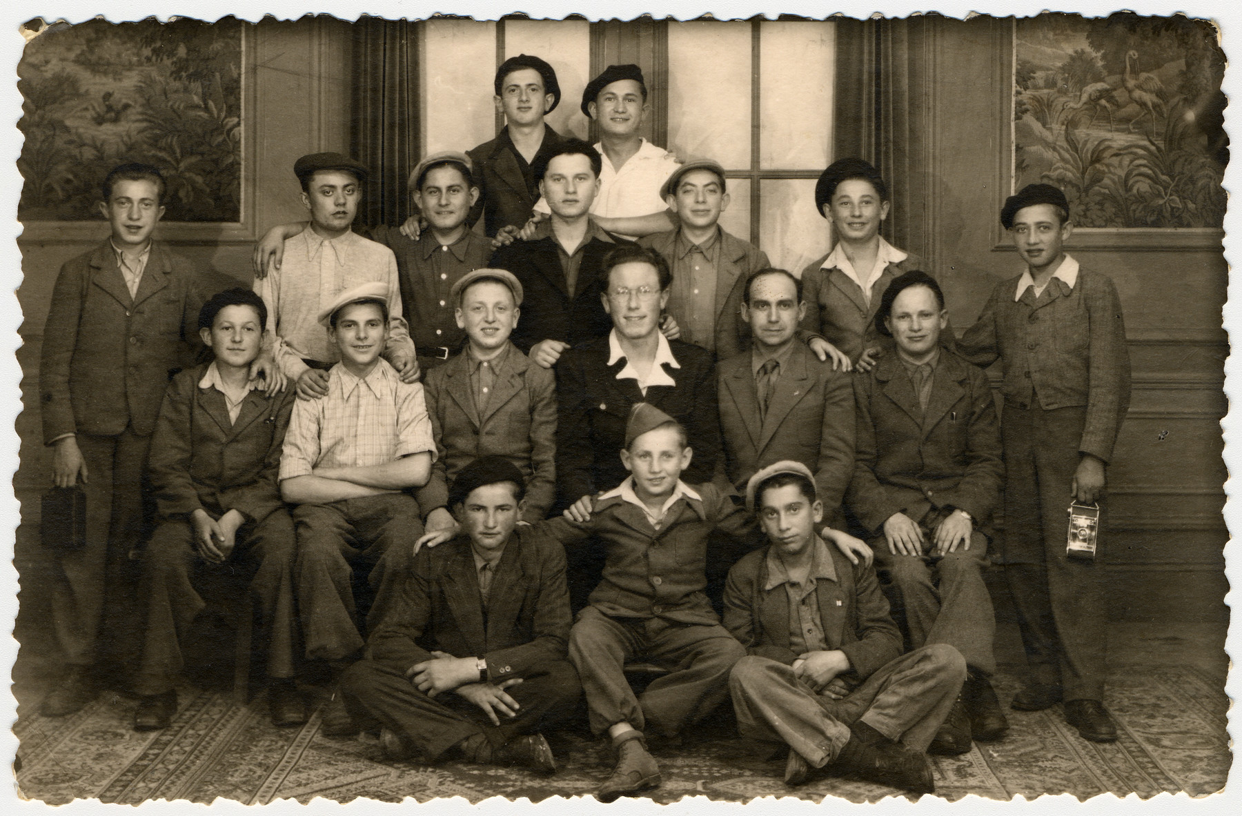 Group portrait of Jewish youth in the Taverny children's home, an OSE home for religious child survivors.  Among those pictured is the donor Jakob Rybsztajn standing on the far right, and Jakub Finelsztajn seated in the front center.