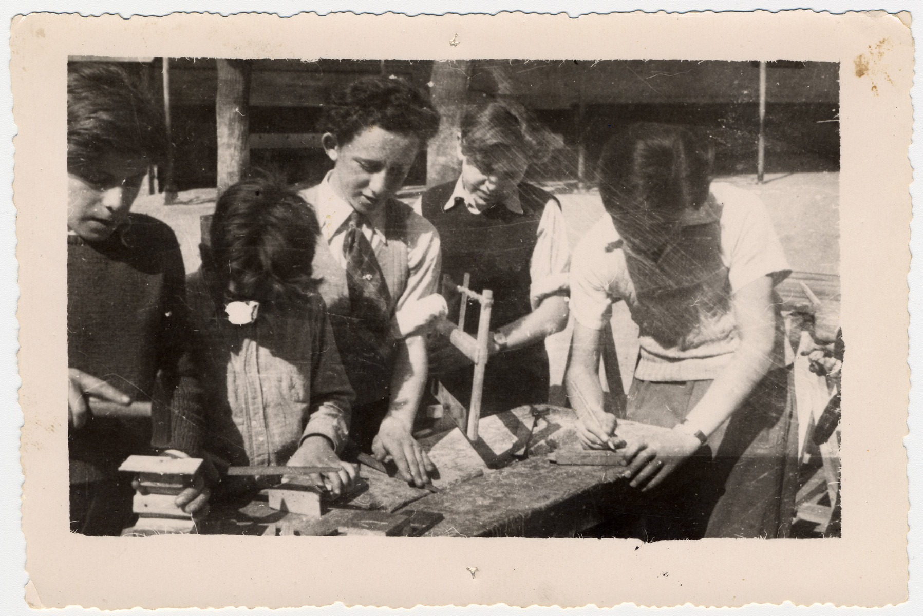 Jewish youth practice woodworking at either the Ambloy or the Taverny children's home.  Among those pictured are Kaliksztajn and Finkelsztajn.
