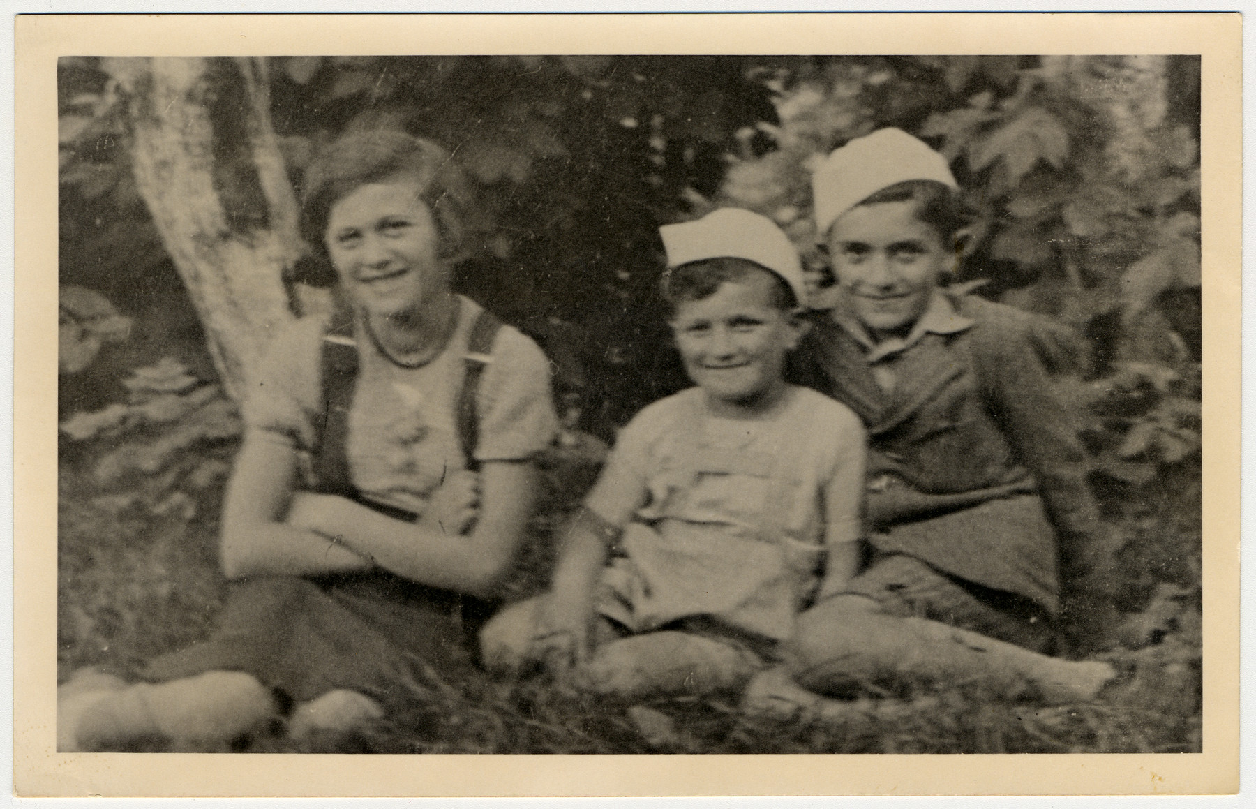 Close-up portrait of three Jewish children in Drohobycz.  Pictured on the far right is Paul Lustig.  [Next to him may be his cousins.]