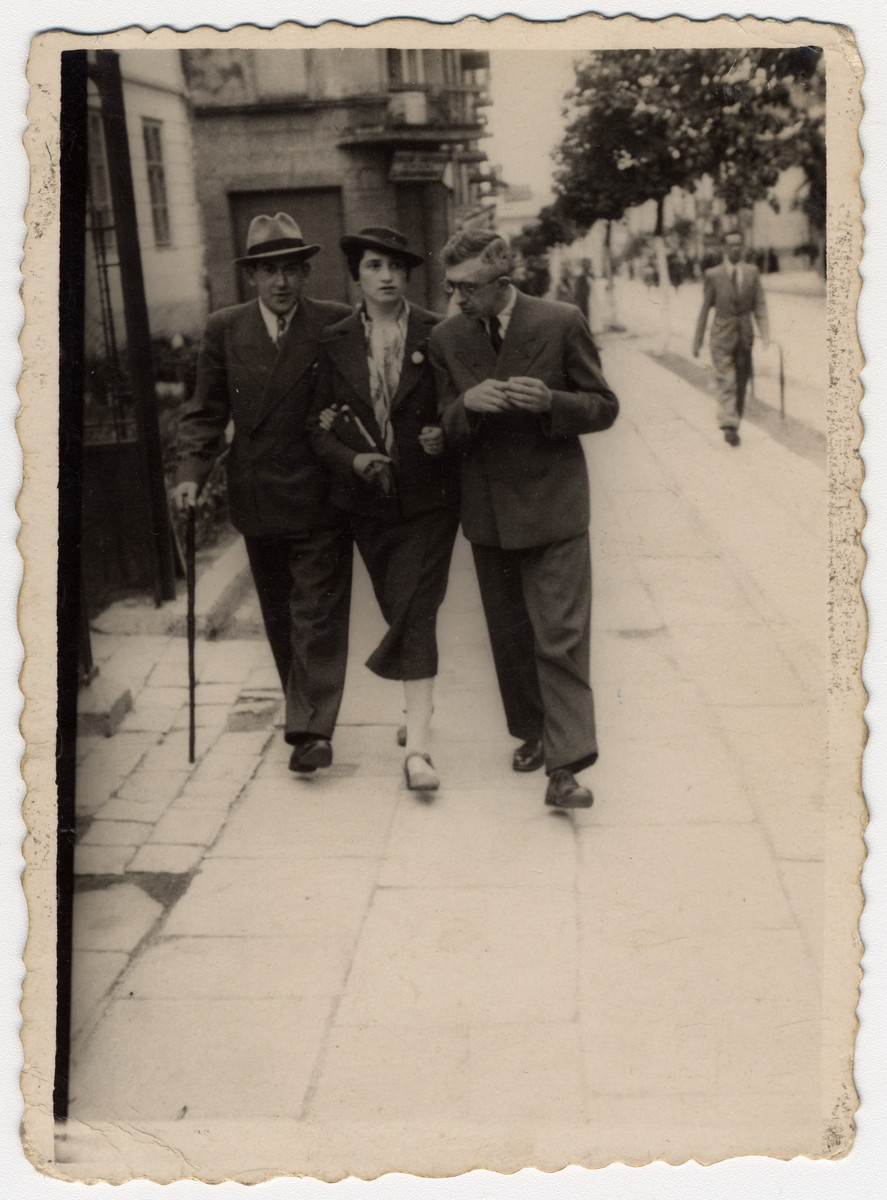 A Jewish couple walks down Rynek Glowny, a commercial street in Drohobycz with a friend.  Pictured are Herman (right) and Otilia Lustig.  They both perished, and this is the last surviving photo of them.  On the left is Izrael (Izio) Liitman (b. May 8,1904) who survived the war.