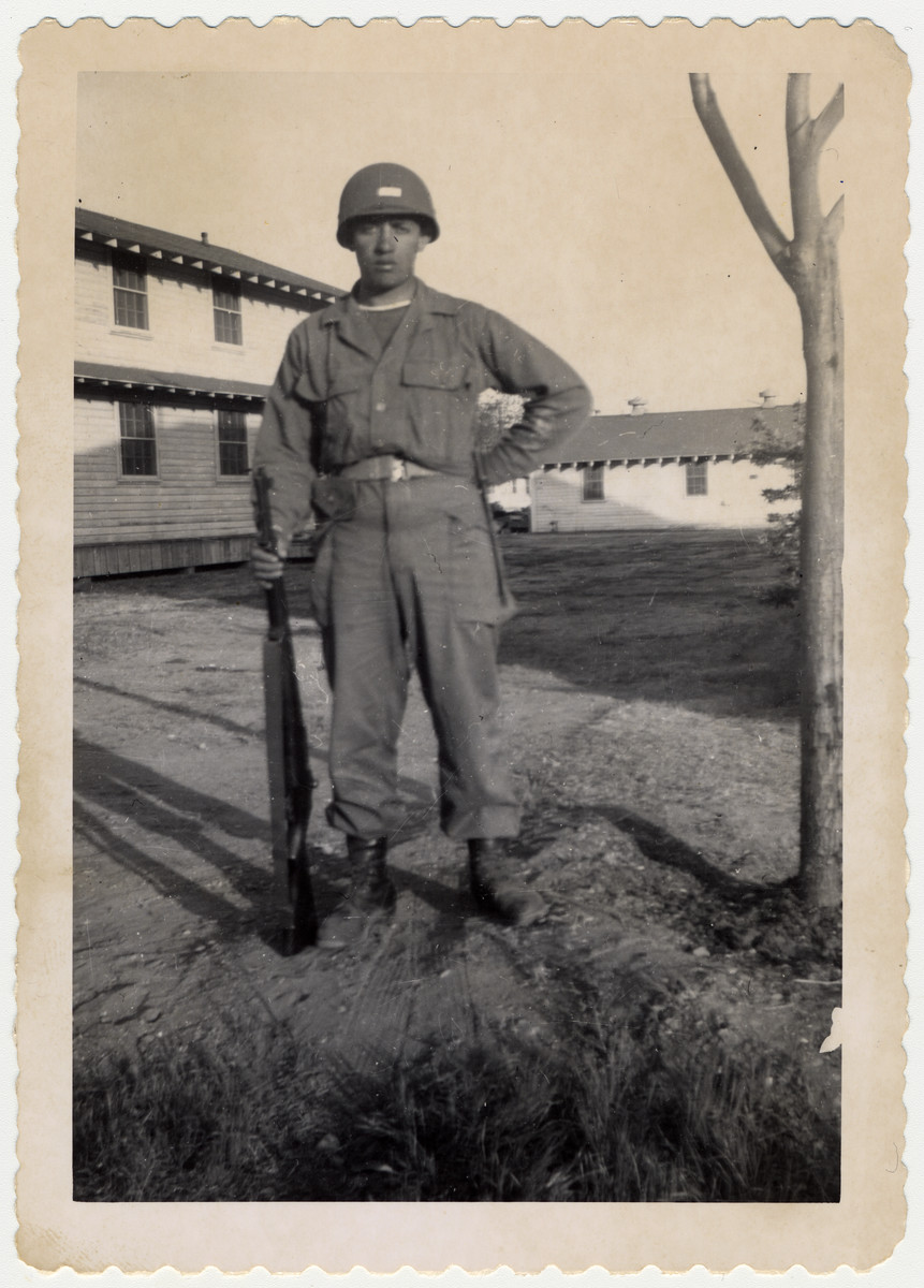 A former child survivor from Buchenwald poses in his American army uniform where he is in training prior to deployment to Korea.