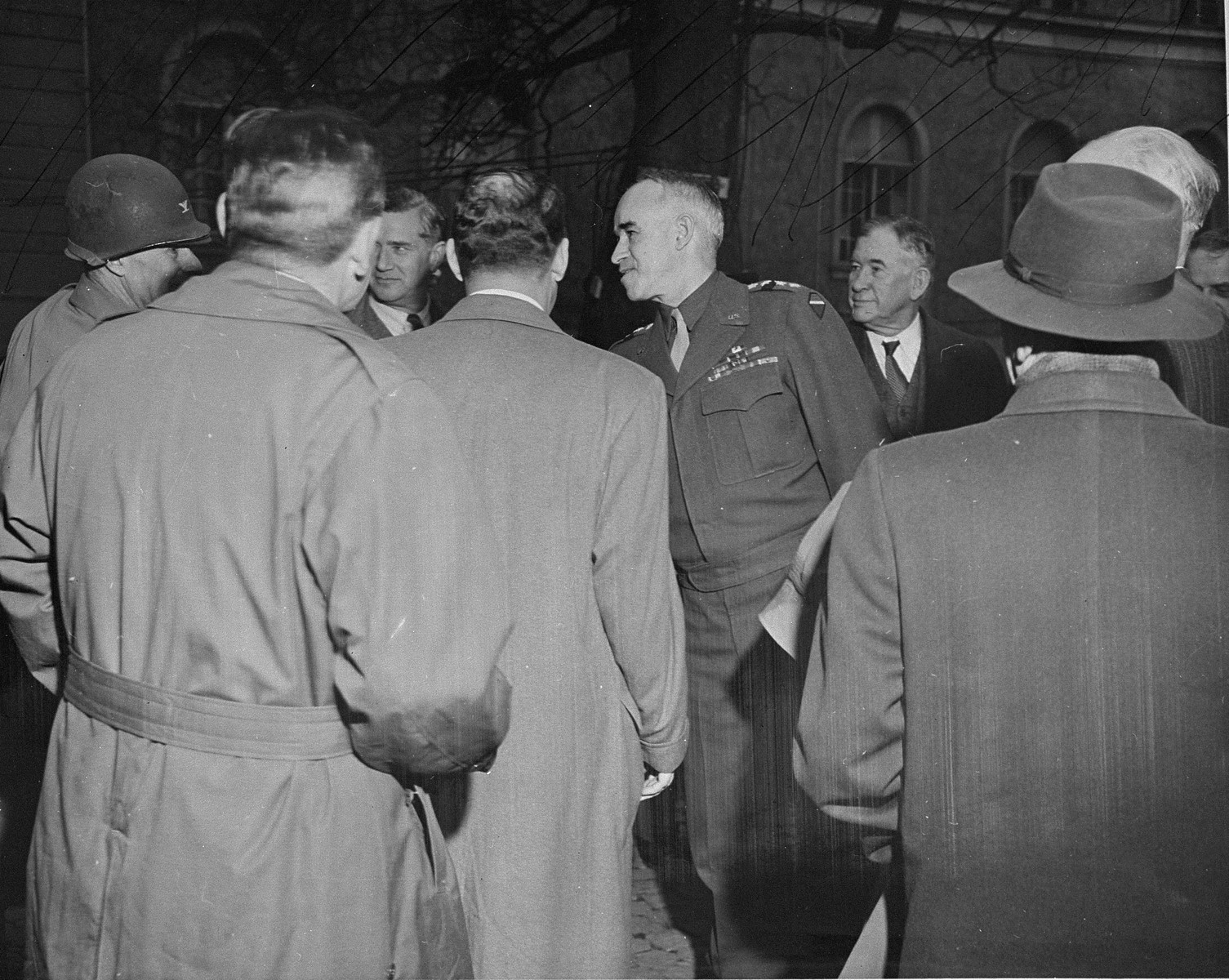 General Omar Bradley greets a group of American congressmen at his headquarters in Wiesbaden.  The congressmen are making a tour of Europe to get first hand information on German atrocities.
