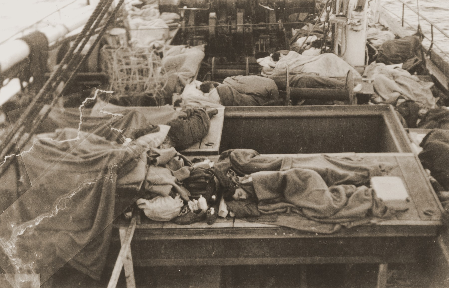 Jewish DPs sleep on the deck of the Mala immigrant ship en route to the new State of Israel.    Passengers would often come on deck during the night to escape the stench in the hold of the ship.  This photograph was taken just after dawn.